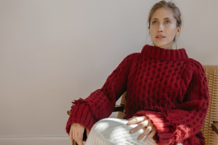 Jenna wears Lorena sweaterhand-knit in Claret and Lilliana sweater skirt in cream   Made in baby alpaca yarns in Peru, with LOVE