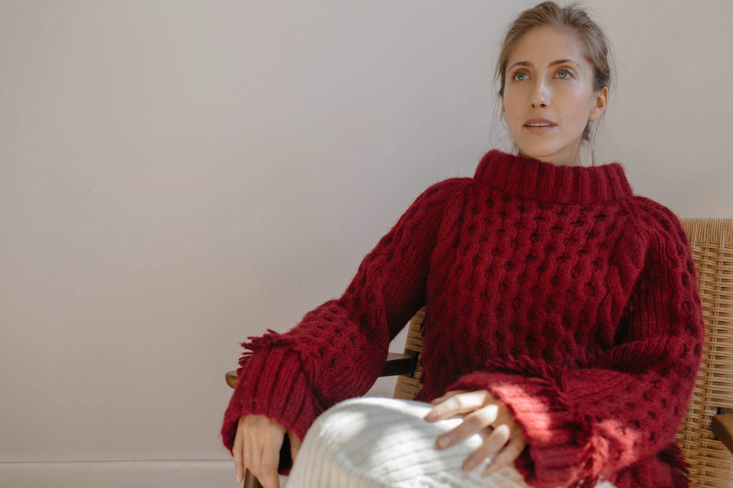 Jenna wears  Lorena sweater hand-knit in Claret and  Lilliana sweater skirt  in cream | Made in baby alpaca yarns in Peru, with LOVE