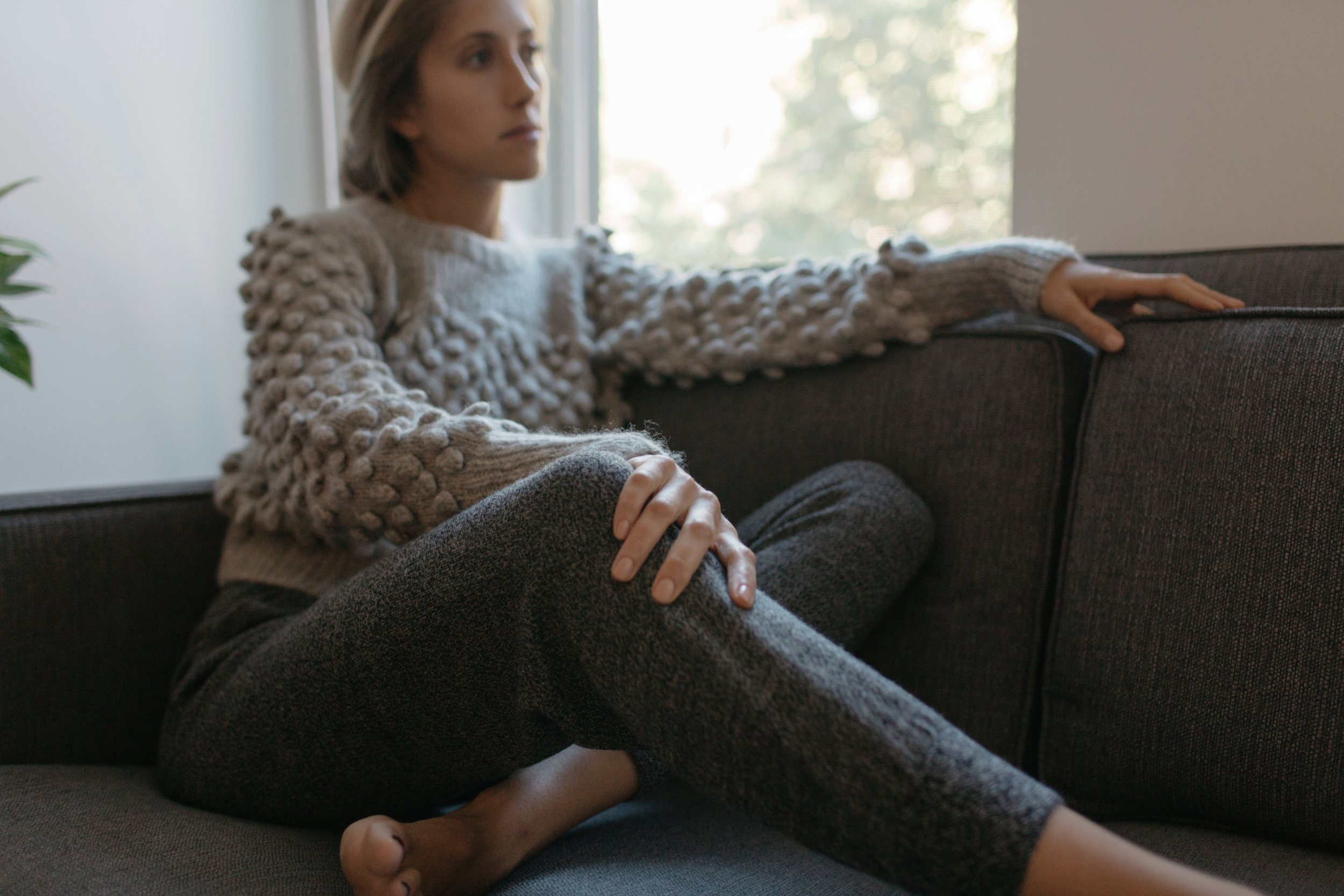 Jenna wears  Camilla sweater hand-knit in mélange grey + Lydia track-pant in Salt & pepper tweed | Made in super-soft baby alpaca in Peru, with LOVE