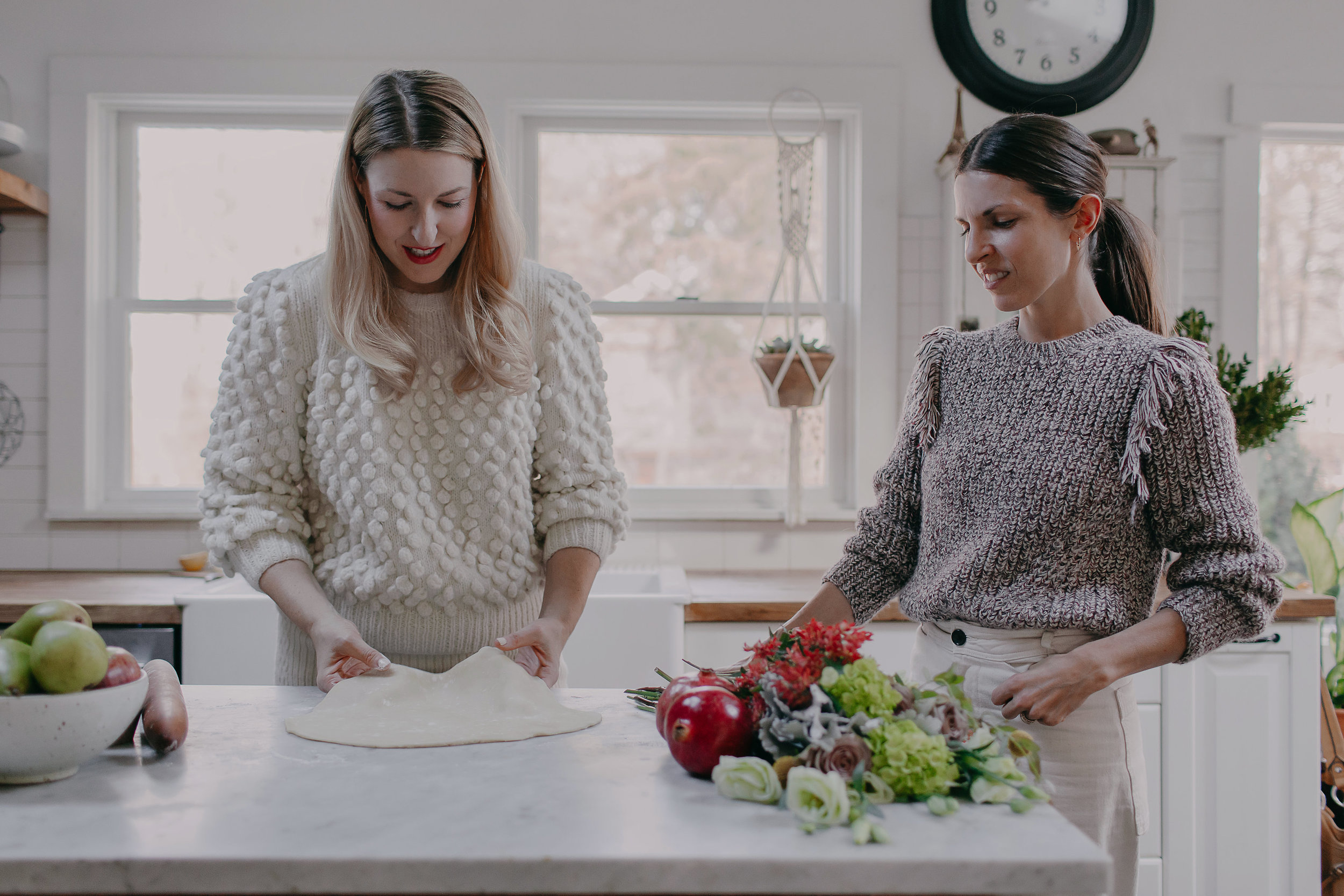 Sarah wears  Camilla sweater and  Lilliana skirt  in cream + Catherine wears  Marina Sweater  in multi tweed. Both sweaters are hand-knit by our Peruvian artisan women in the softest baby alpaca yarn.
