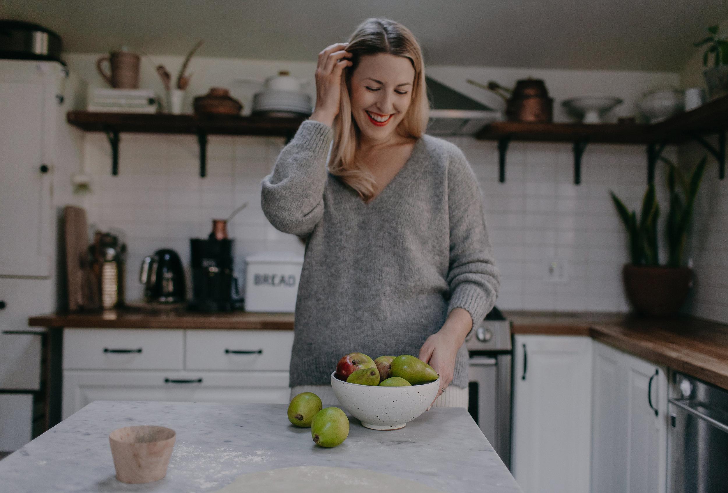 Sarah wears  Talia vee sweater  in melange grey, made in Peru in baby alpaca yarn