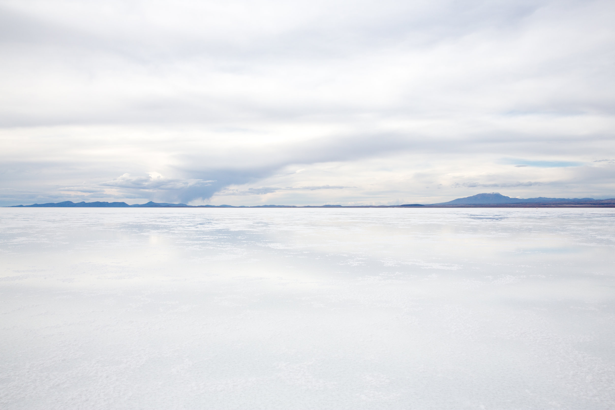 After the rainy season some areas of the Salt Flats keep a shallow lake of water. The reflective effect is luminous and serene!