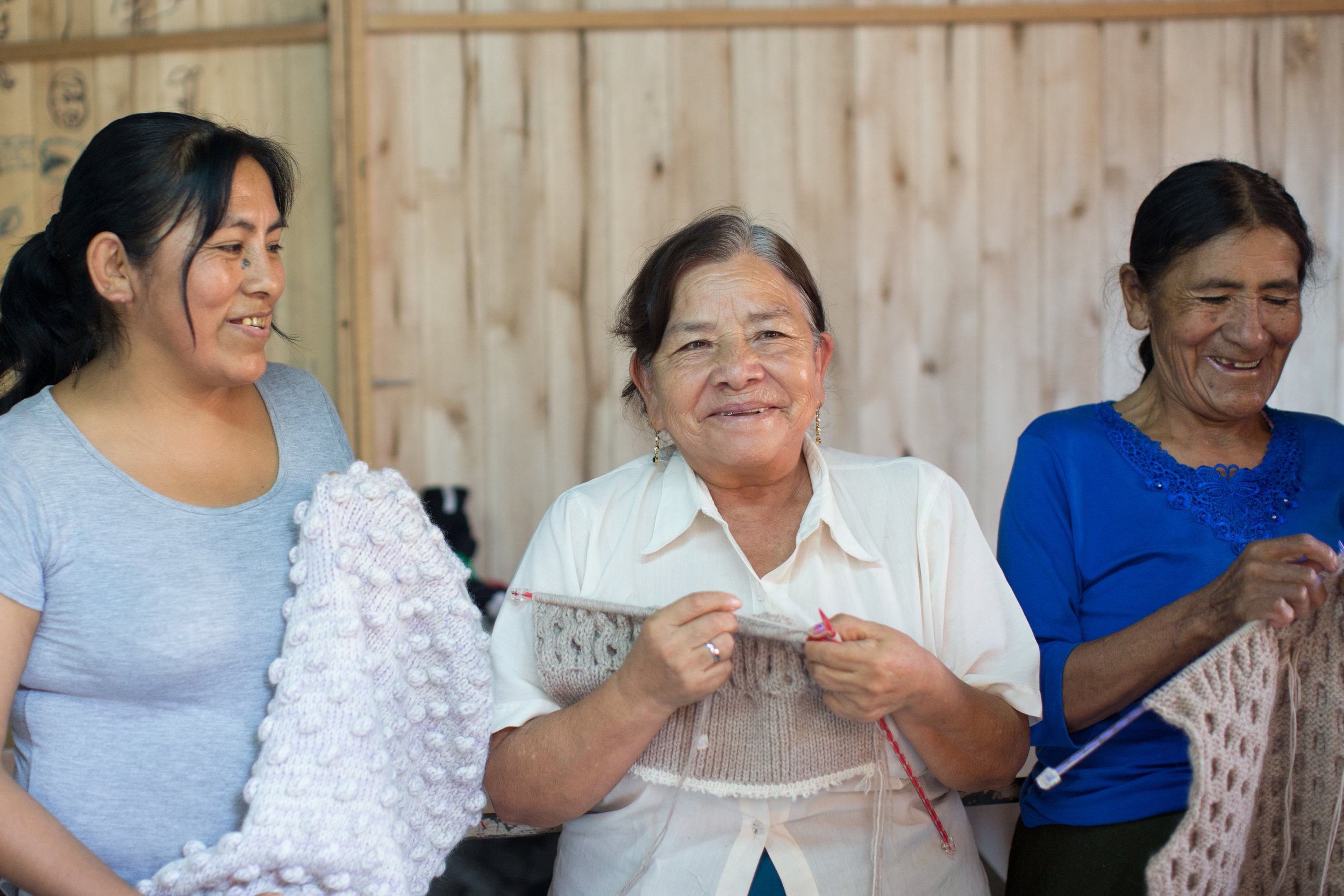 Meet artisan Judith (left) with her Mother (center) and Auntie (right) at a family run workshop on the outskirts of Lima. Her husband, brother-in-law and nephews work on the hand-flat knitting machines and the women-knit by hand. They are working on our Fall 18 production.