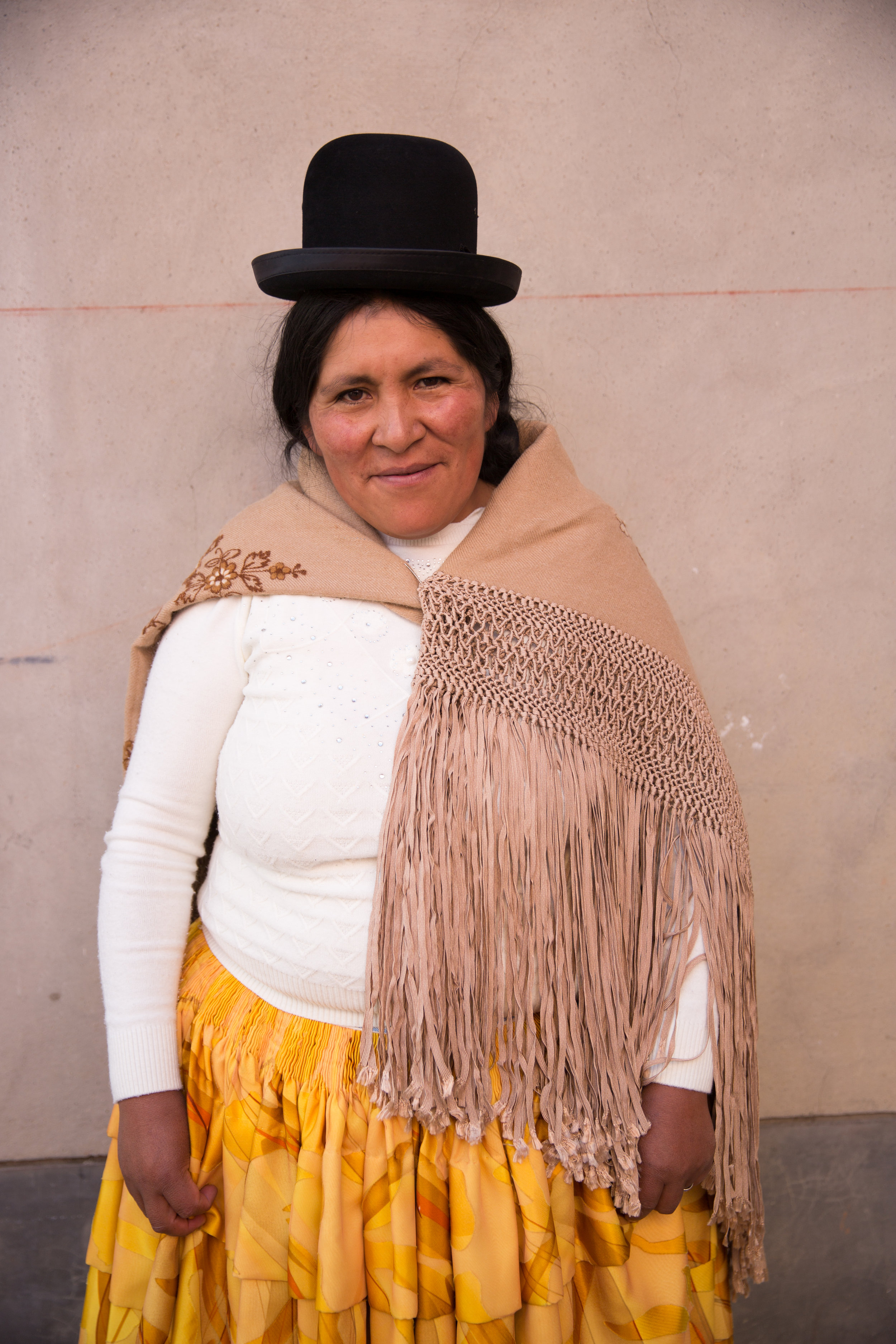 Meet artisan Ana Quea. Often the color combinations of the artisans outfits incredibly inspiring. We incorporate and use of the rayon tape yarn that the artisans macramé their shawls from within some of our ELEVEN SIX pieces.