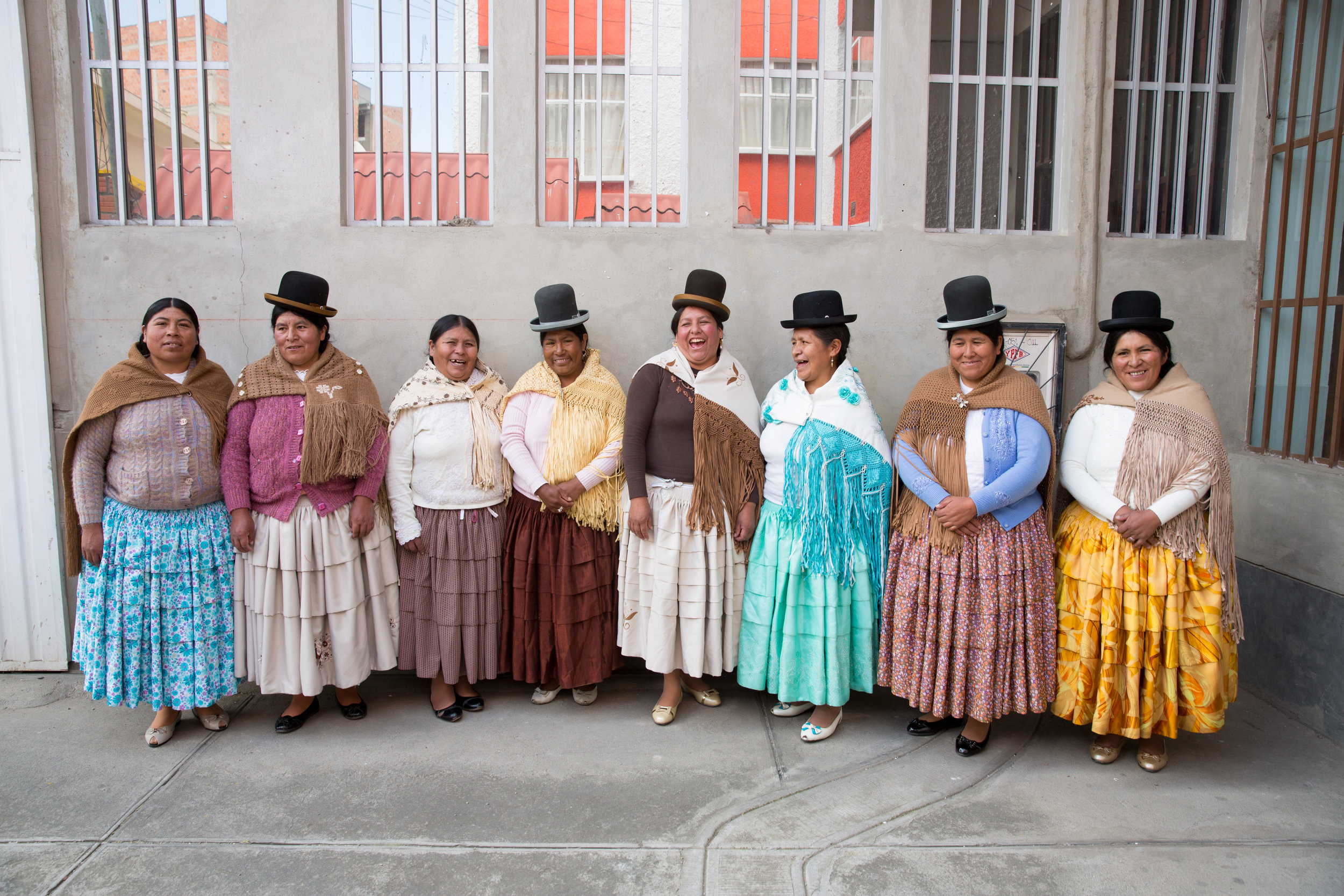 In La Paz, Bolivia visiting the women's cooperative we work with. These traditionally dressed artisan women are known as Cholita's and are a symbol of cultural identity. They wear their dress with pride daily as it celebrates their femininity, elegance and pride. Its incredible that they work in their bowler hats all day long!