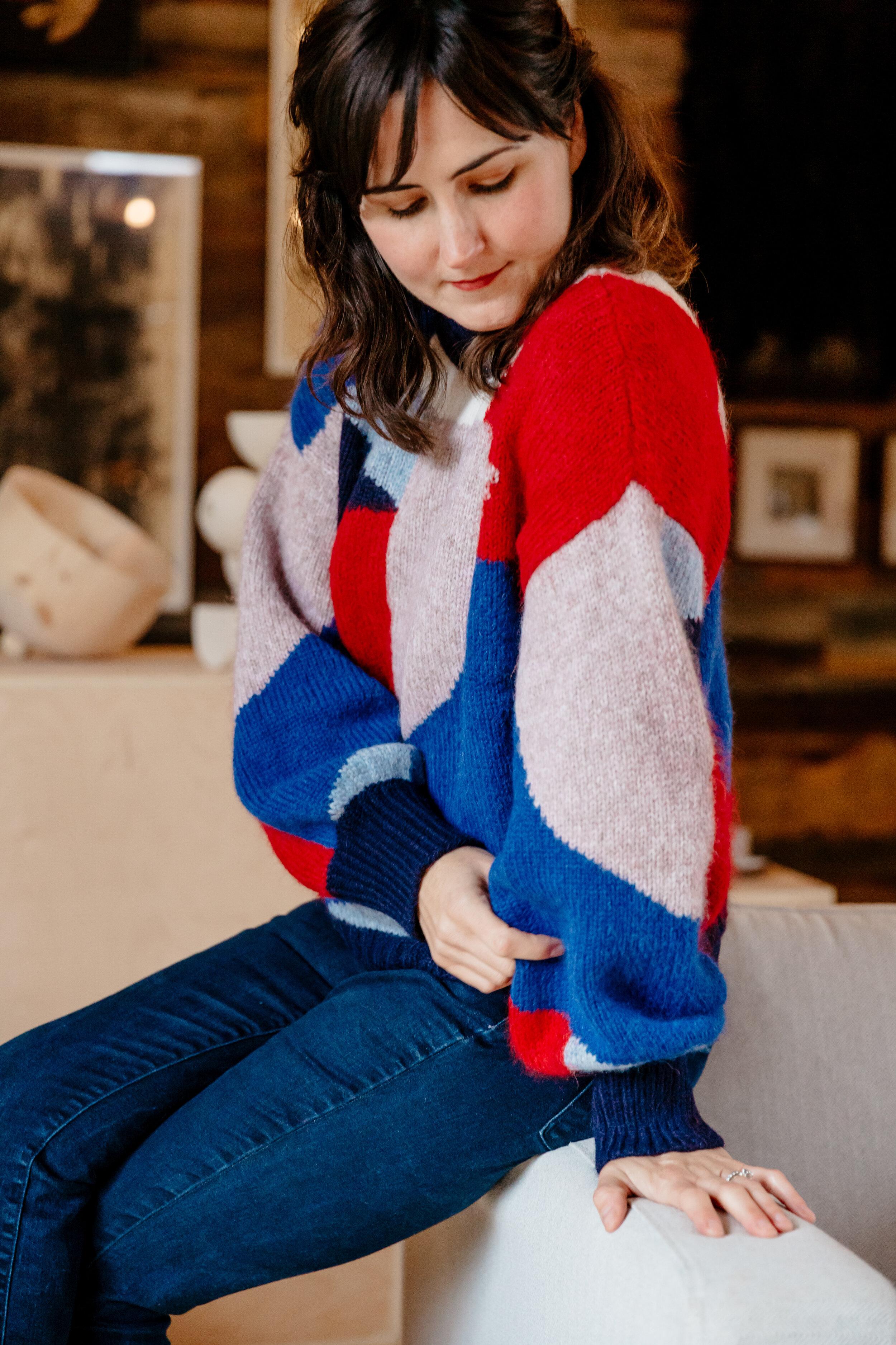 Dana wears Fall 19  Caroline Sweater : a design collaboration with Swiss-artist  Caroline Denervaud .
