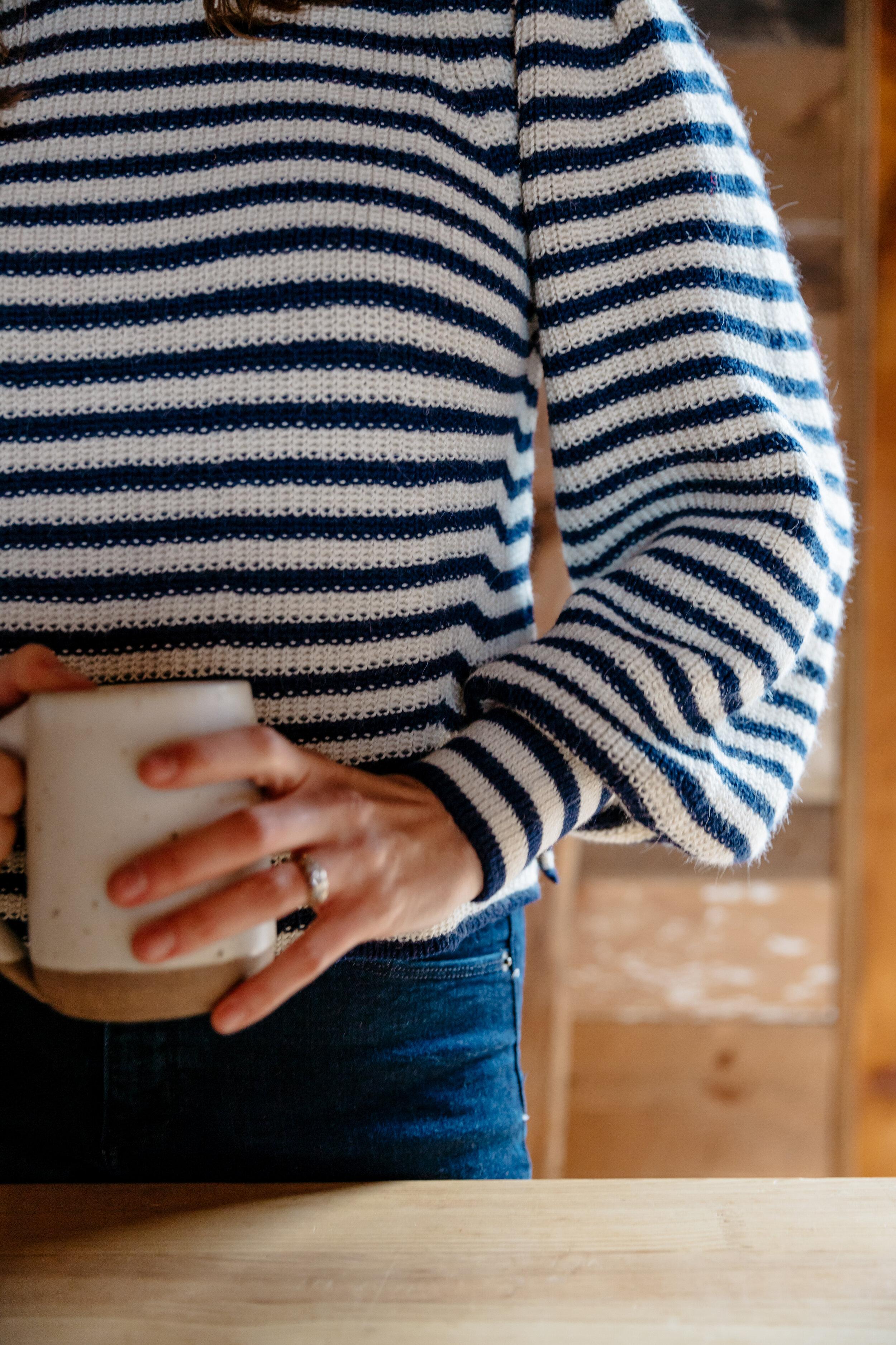 Dana wearing Fall 19  Mia sweater  in stripe with  Lail Design  ceramic coffee mug