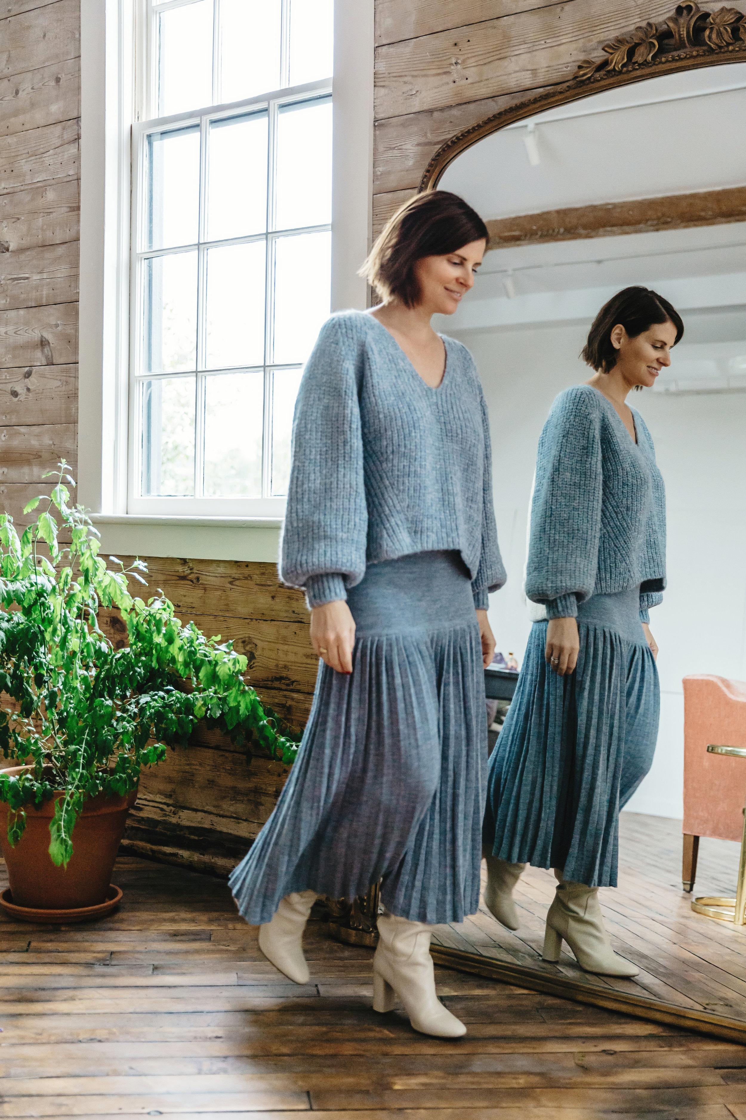 Courtney wears  Tess sweater  in Cloud blue/Ivory +  Lea skirt  in Cloud blue