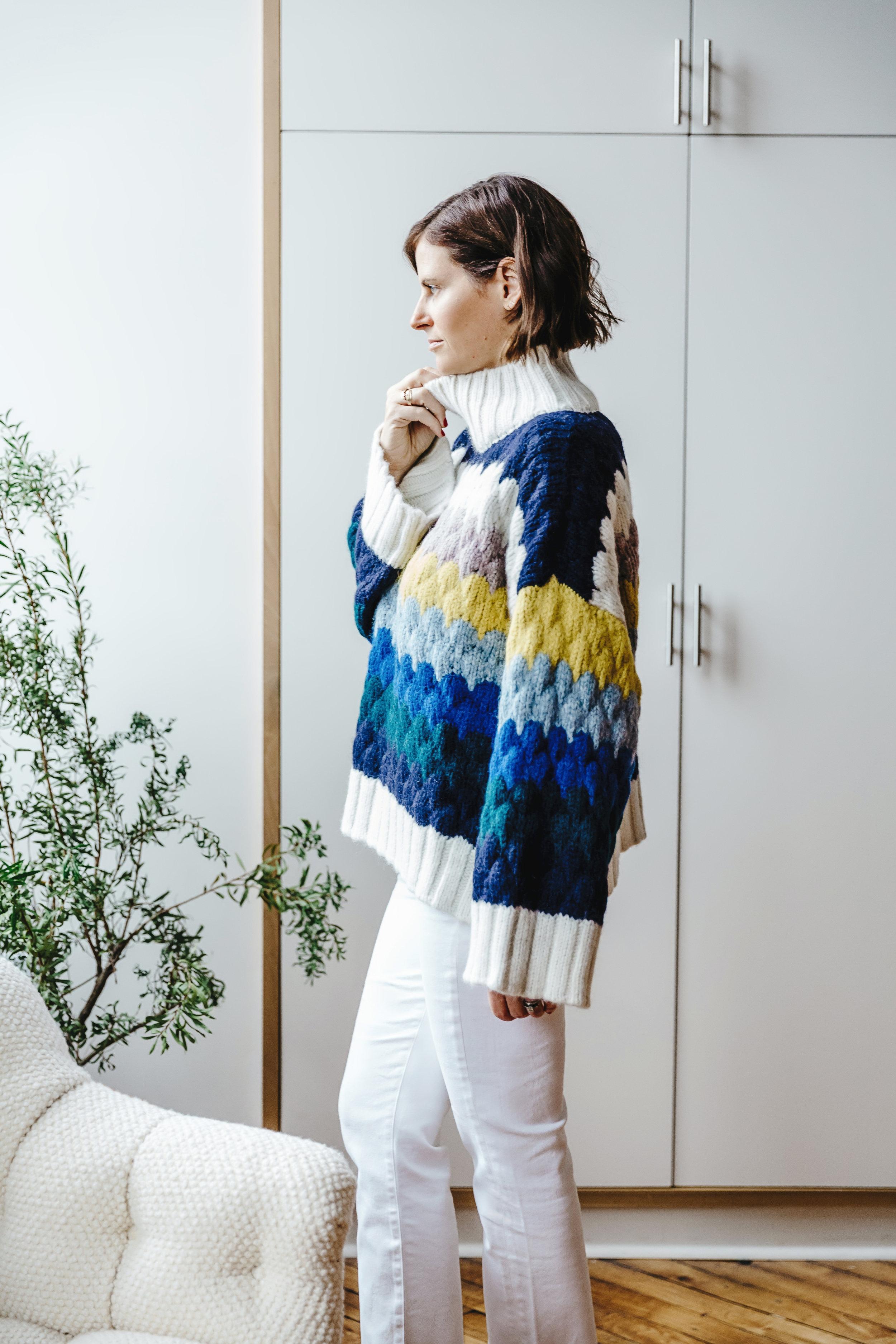 Courtney wears the  Freya sweater  in Multi-color