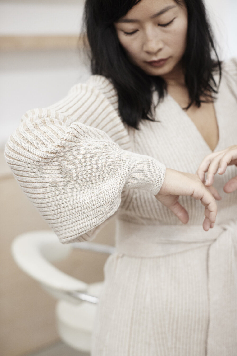 RJ wears   Ines sweater dress   in Ivory & Pale camel combo styled back to RJ's own jean.