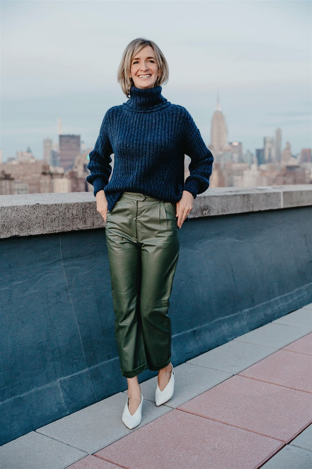 Ali wears:  ALI T-neck Sweater  (her name-sake sweater) ( SHOP HERE ) styled back to Ali's own vintage leather pant