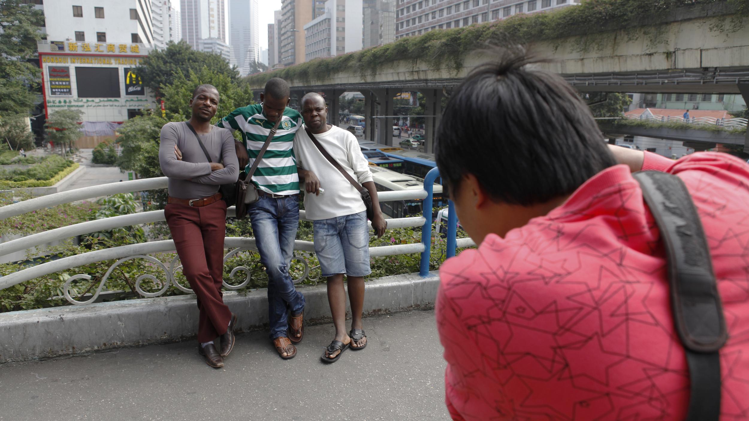 Zeng Xian Fang at work on the pedestrian bridge in Xiaobeilu