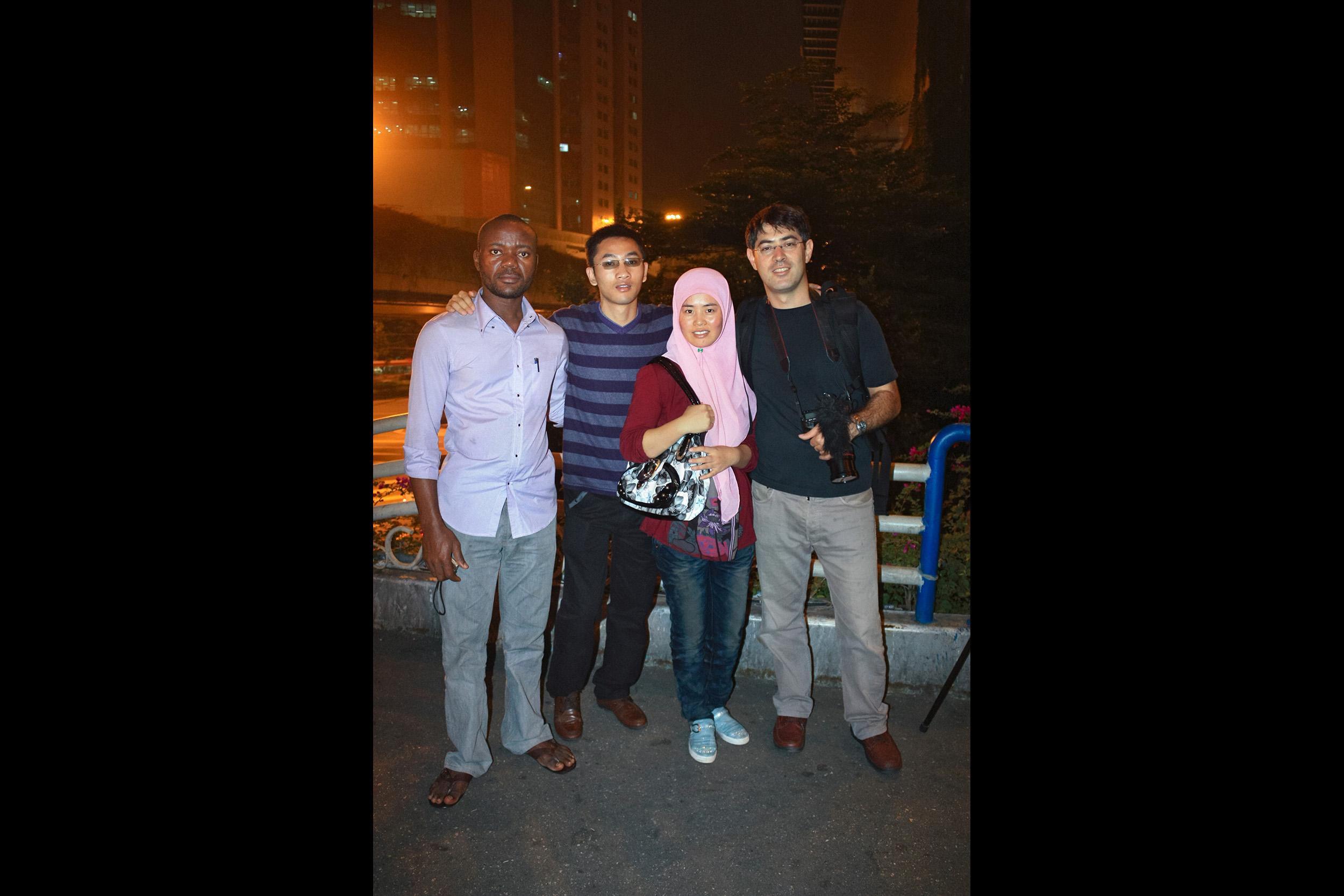 Daniel Traub with three of Zeng Xian Fang's customers