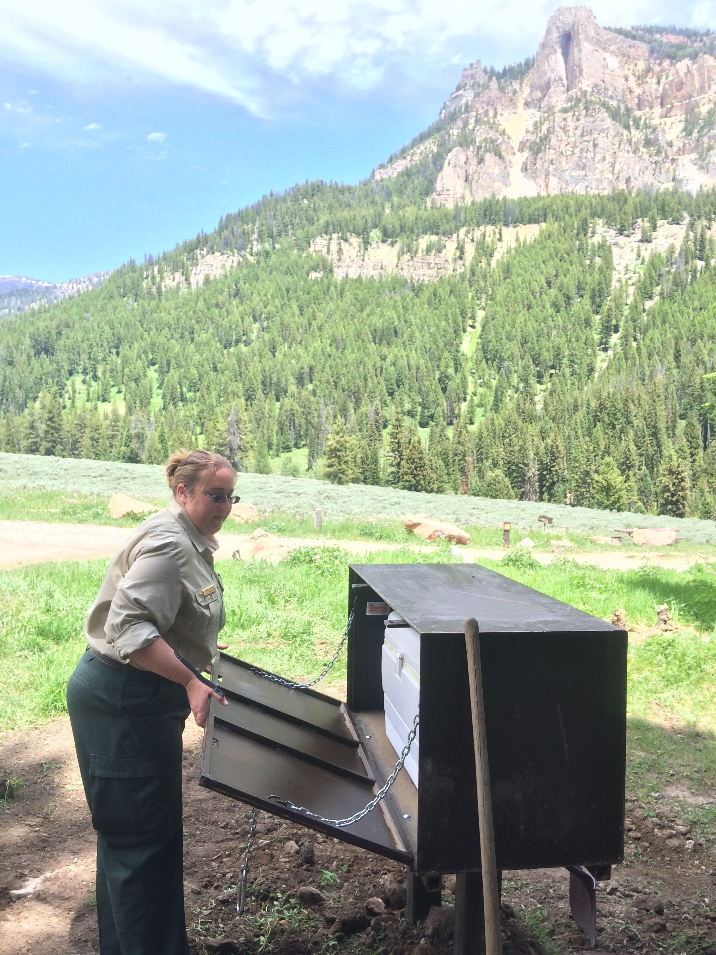 Forest Service staff with the new bear boxes at Granite Creek Campground. (Photo GYC.)