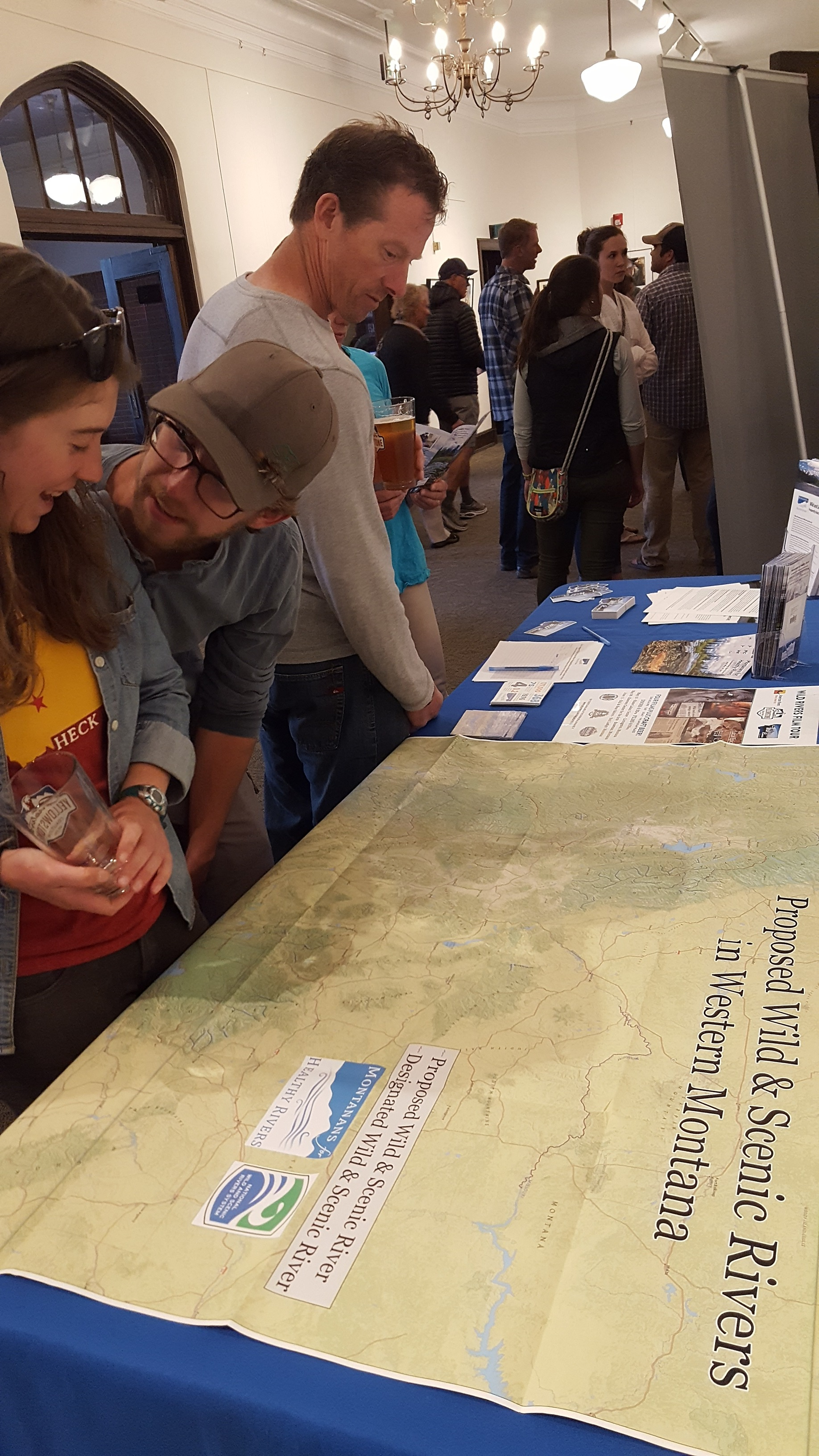 Filmgoers at our May 26 Wild Rivers Film Tour have a look at the map of rivers we're working to protect in southwest Montana. You can help - make your voice heard and protect these rivers today! (Photo GYC.)