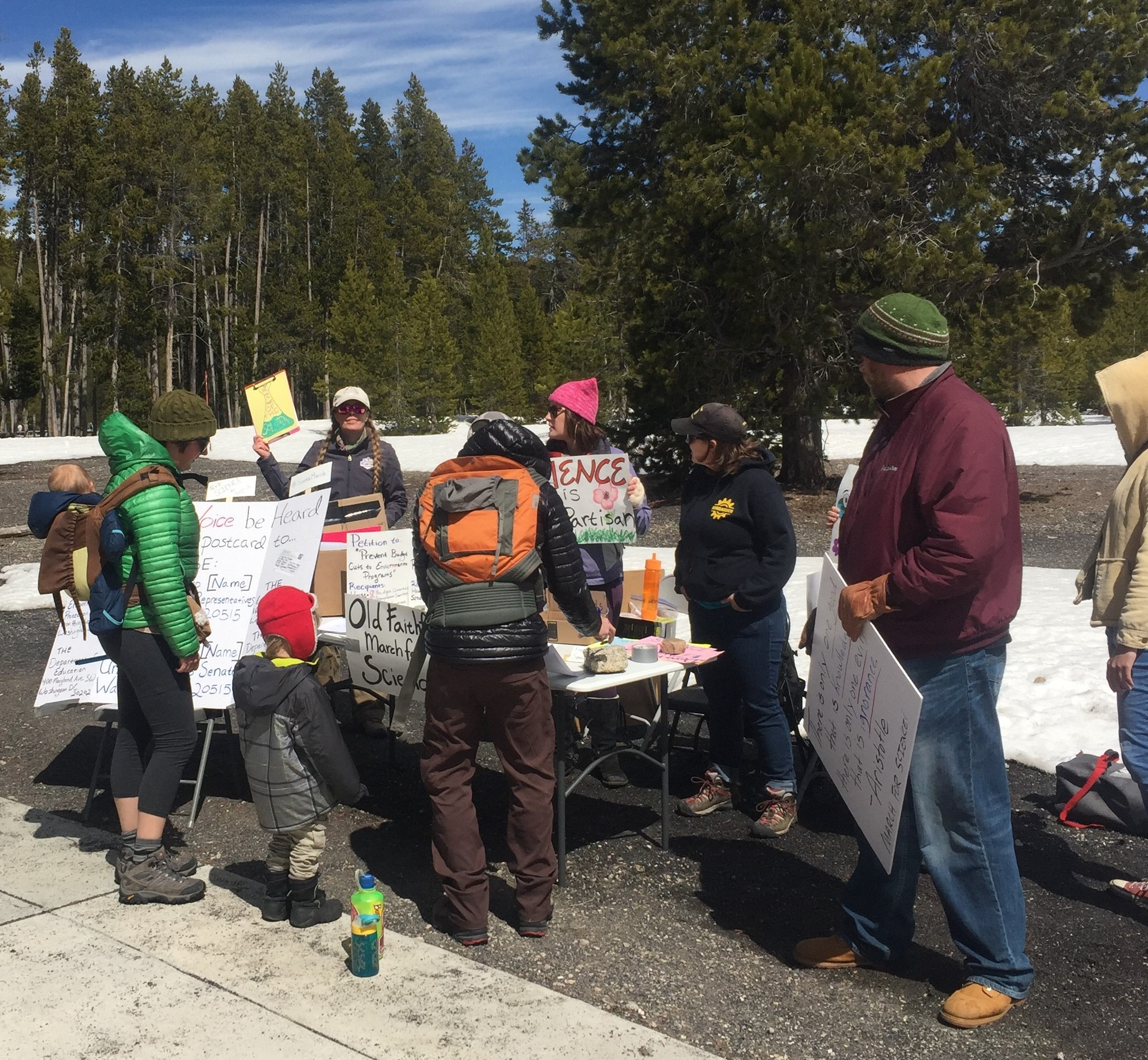 GYC's Jenny DeSarro (second from left, holding yellow sign) tables at the March for Science in Yellowstone National Park on Saturday. (Photo courtesy Matt Hall.)