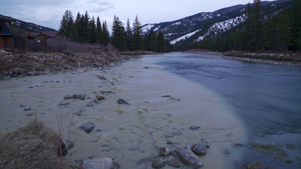 Treated sewage flows into the Gallatin River after a holding pond failed in March 2016. We're working to make sure this never happens again. (Photo courtesy Explore Big Sky.)