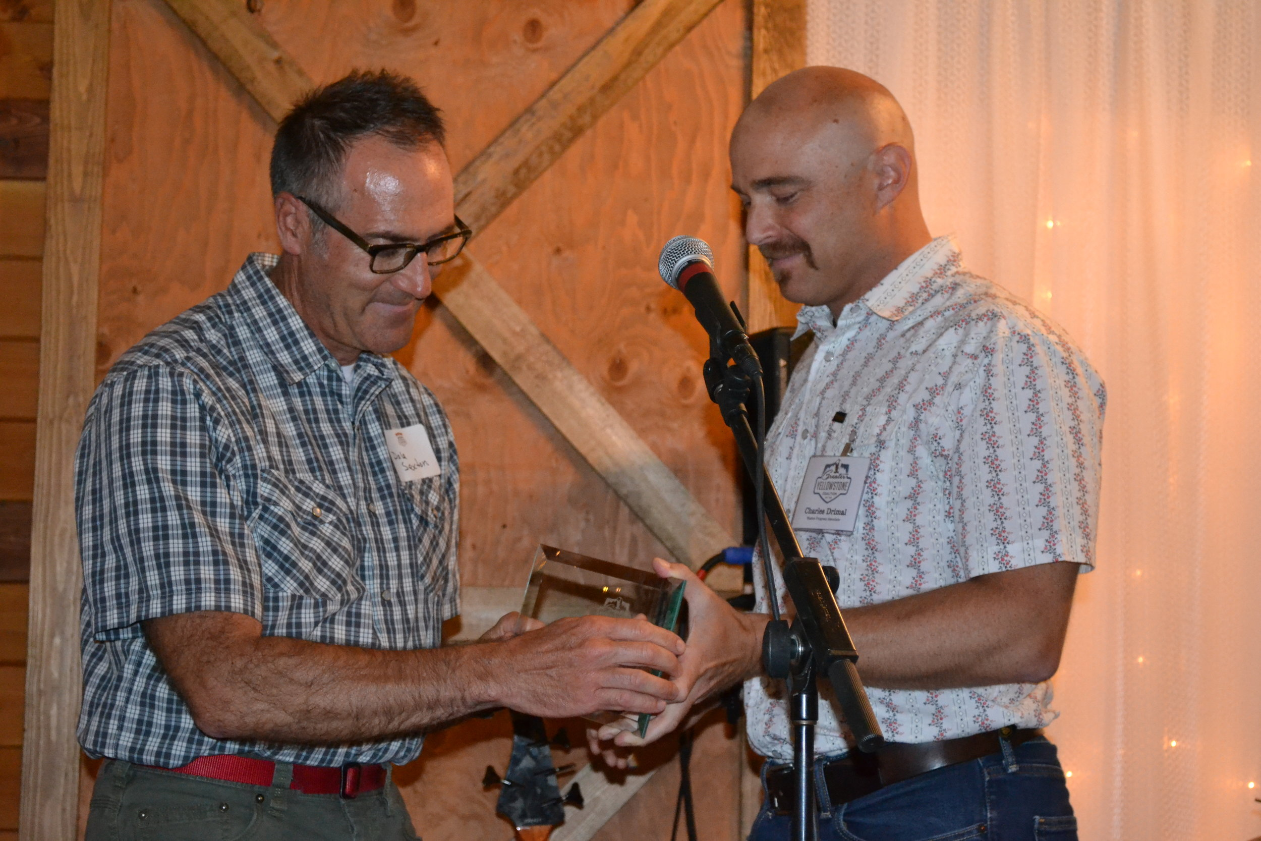 Charles Wolf Drimal of GYC (right) gives Dale Sexton the Grassroots Activism Award. (Photo courtesy GYC.)