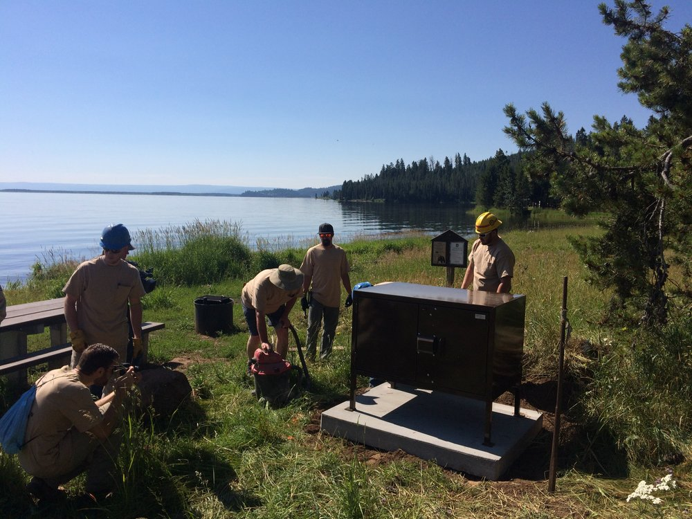 A crew installs a bear box at the Hebgen Lake campground in Montana. (Photo GYC.)