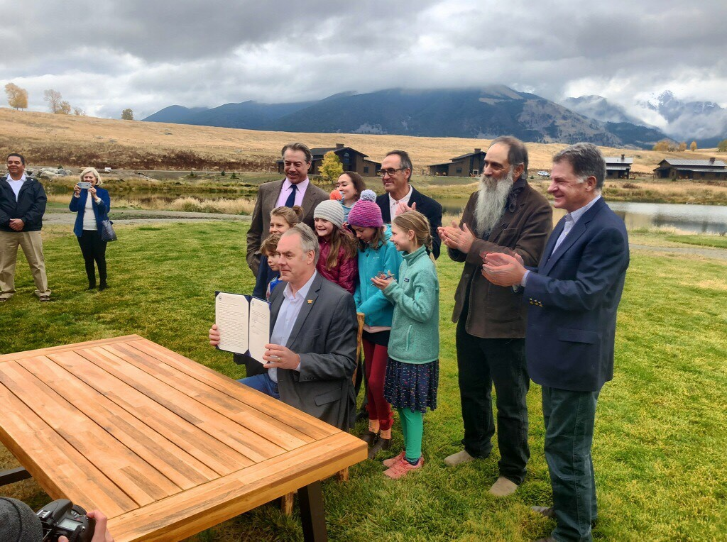 Secretary of the Interior (now former) Zinke signs a 20-year mining timeout for Yellowstone's northern gateway at Sage Lodge. (Photo GYC.)
