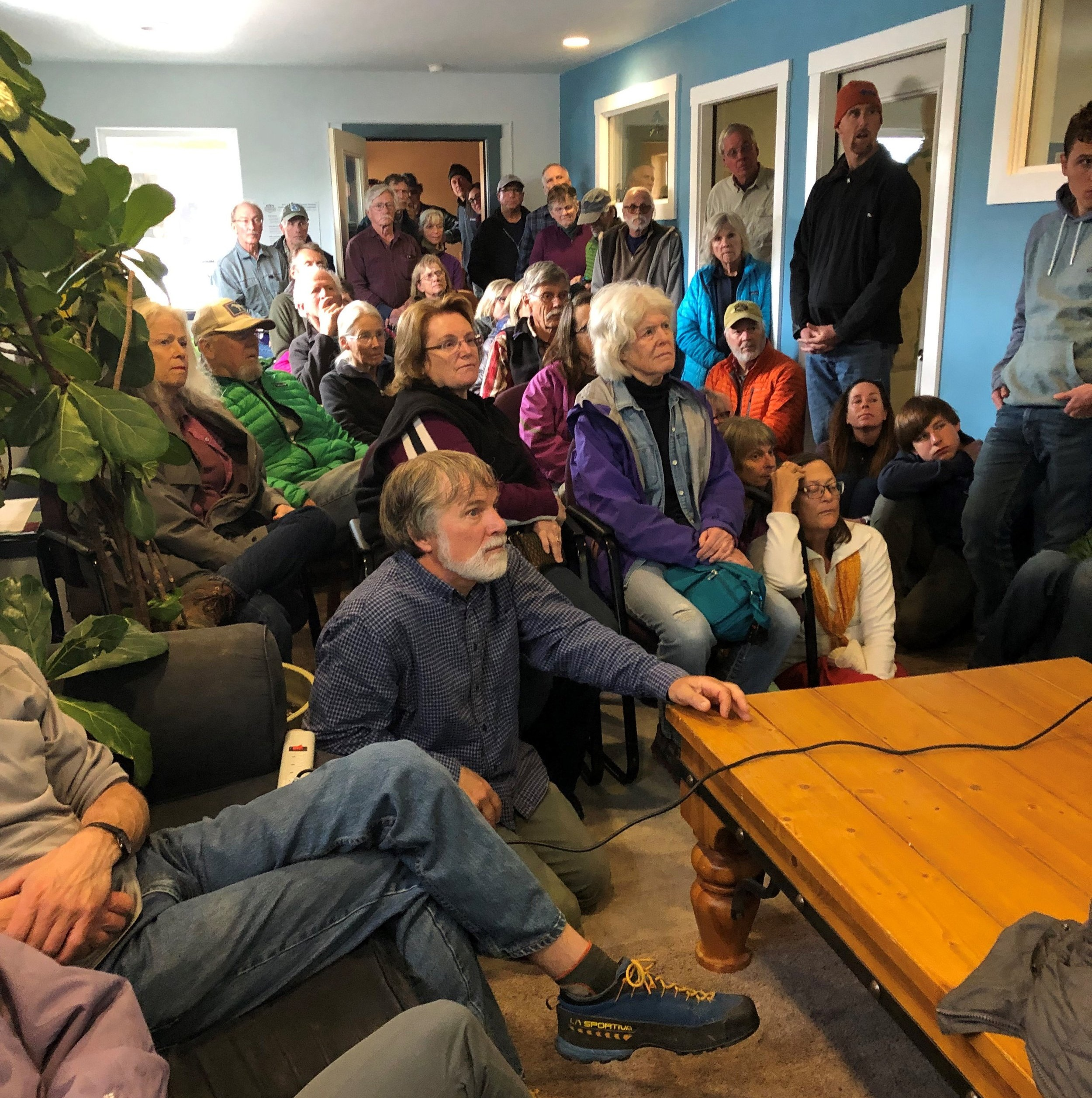 Recreationists pack the GYC Driggs office for a bear safety presentation by Jeremy Nicholson, Idaho Fish and Game's bear biologist. (Photo GYC/Allison Michalski.)