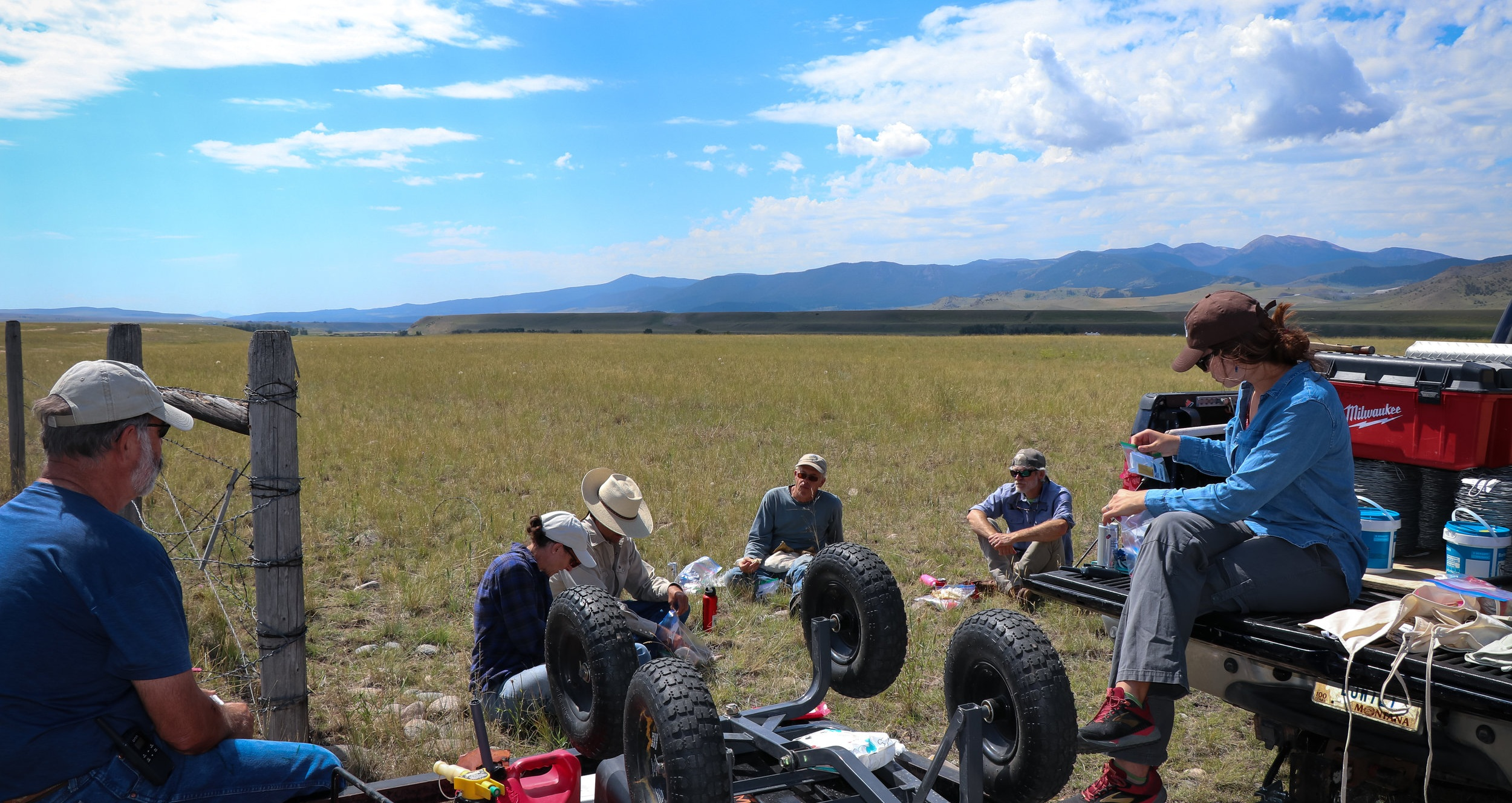 The crew eats lunch after a long morning of removing barbed wire. (Photo GYC/Emmy Reed.)