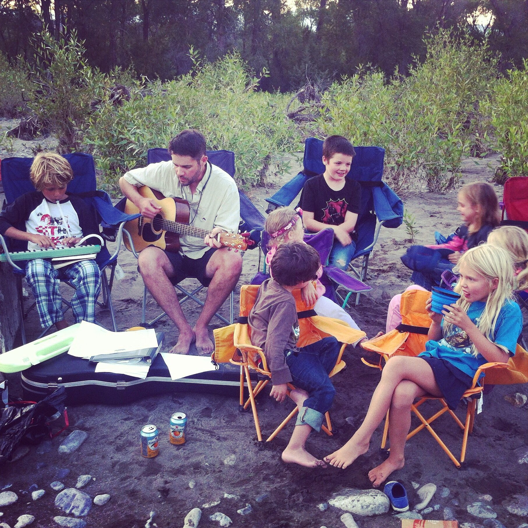 Scott and his mini crew relaxing after a long day on the Yellowstone River. (Photo Scott Christensen.)