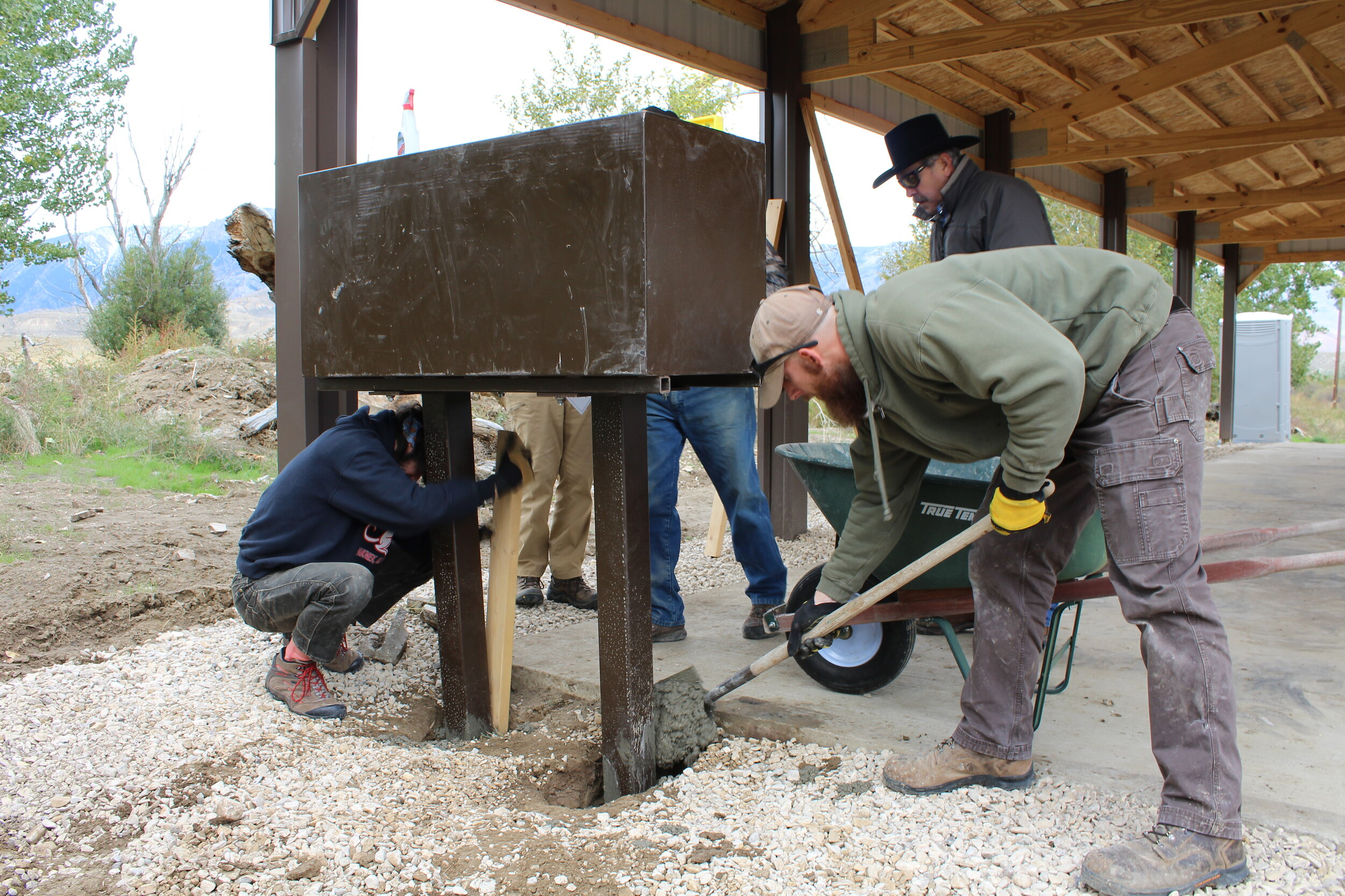 Volunteers place a bear box to keep bears alive and people safe. (Photo GYC/Emily Reed.)
