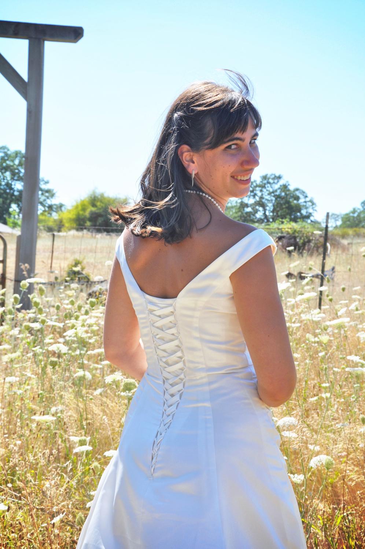 04. Weddings-Bride-Back-Dress_Carly-Carpenter.jpg