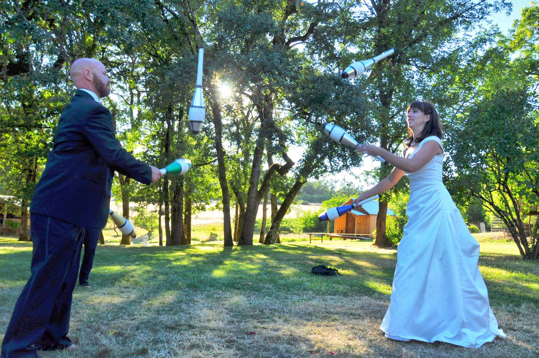 27. Weddings-Bride-Groom-Juggling-Pins_Carly-Carpenter.jpg