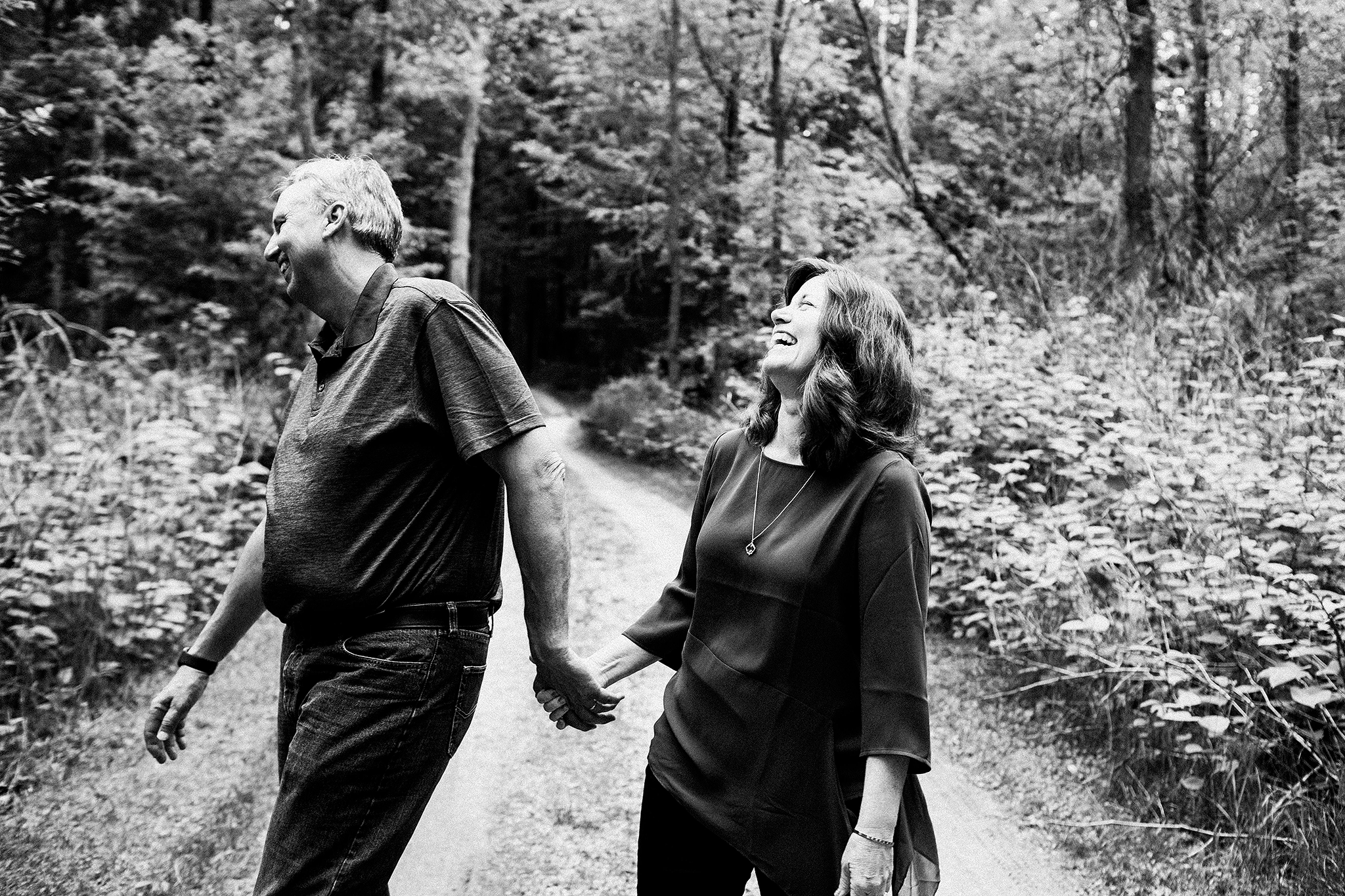Mature couple laughing in the forest | Sheboygan, WI photographer | Chrissy Deming photography