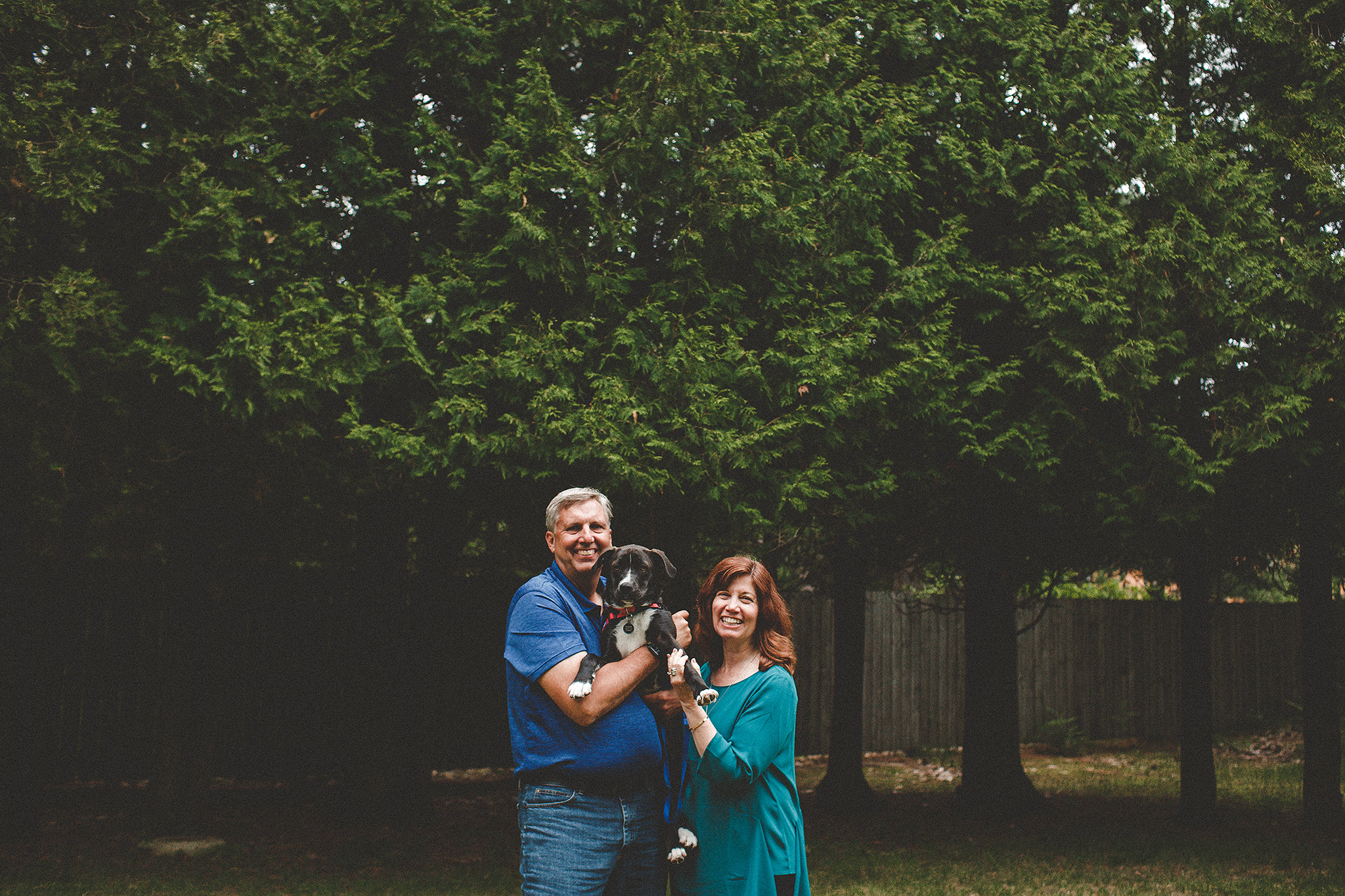 Mature couple holding dog in the forest | Sheboygan, WI photographer | Chrissy Deming photography