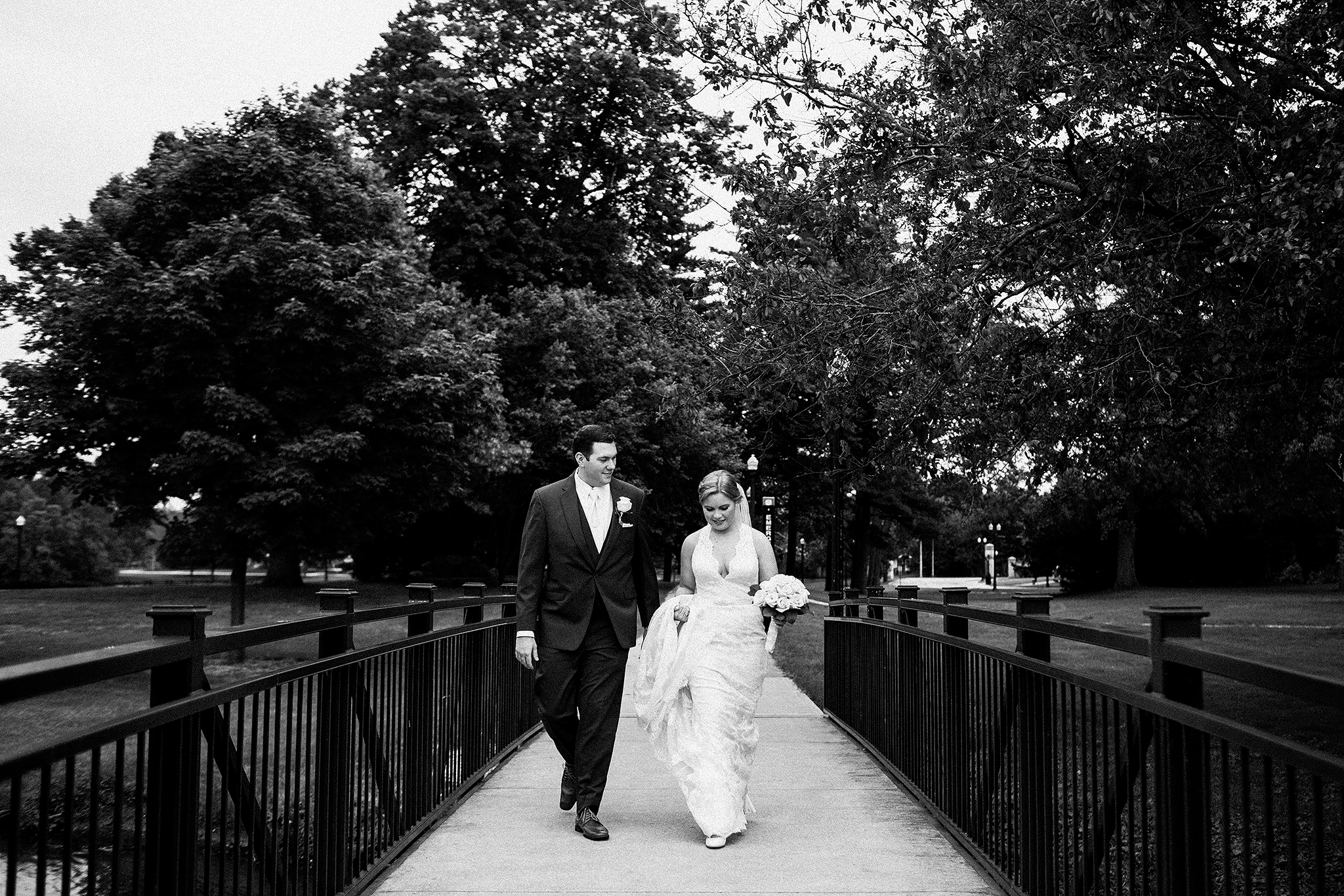 black and white portrait of bride and groom walking | dekalb IL wedding photographer | chrissy deming
