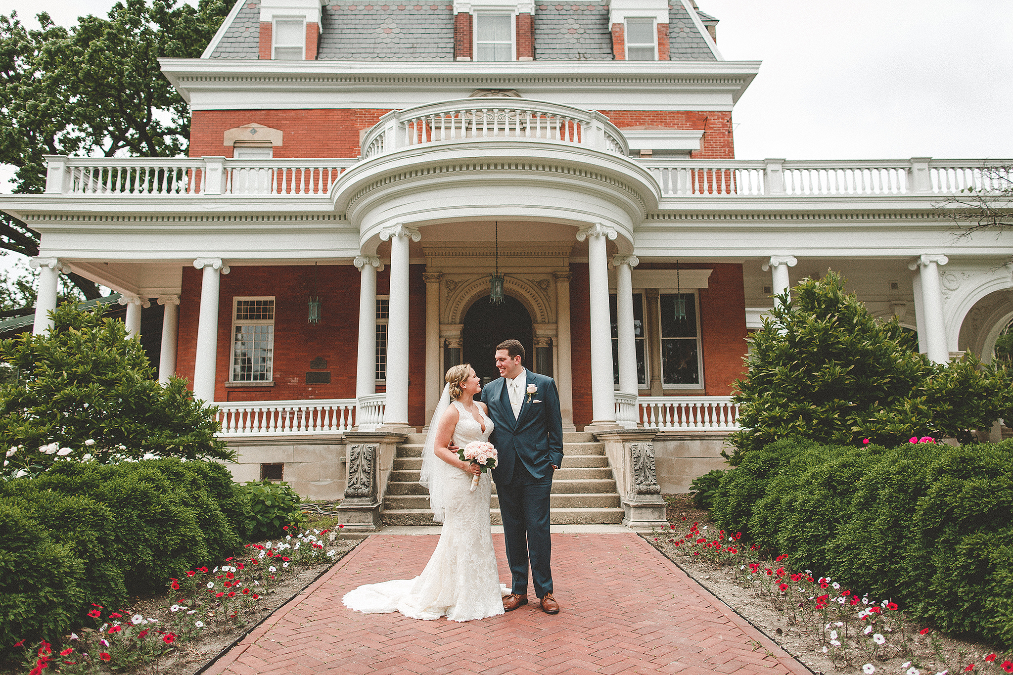 wide portrait of bride and groom looking at each other at ellwood house | dekalb, il wedding photographer