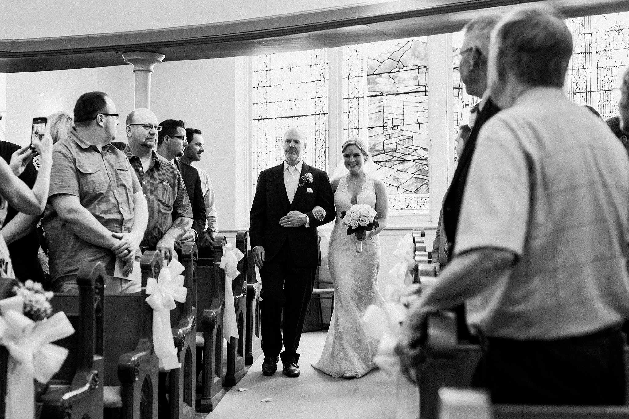 bride and father of bride walking down aisle | first united methodist church | dekalb, Il wedding photographer
