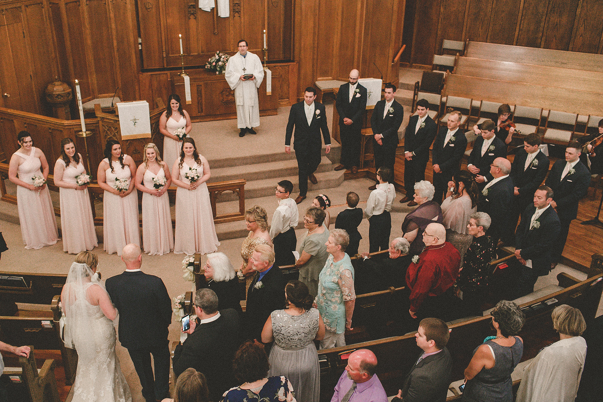 bride walking down aisle photographed from above and behind | dekalb il wedding photographer