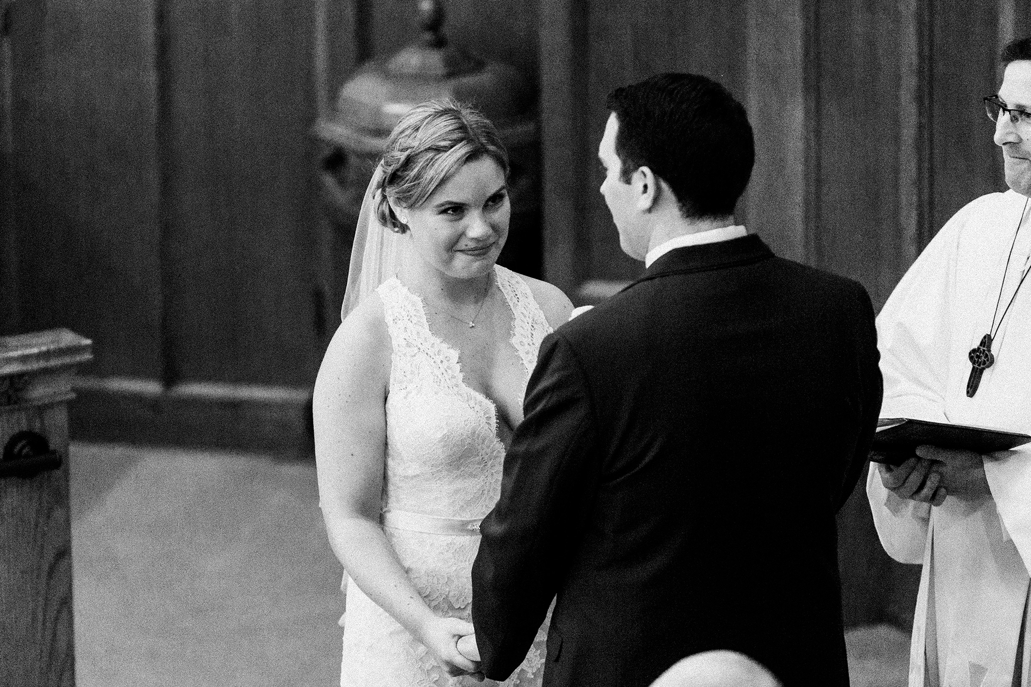 black and white image of bride and groom at the alter | dekalb, il wedding photographer