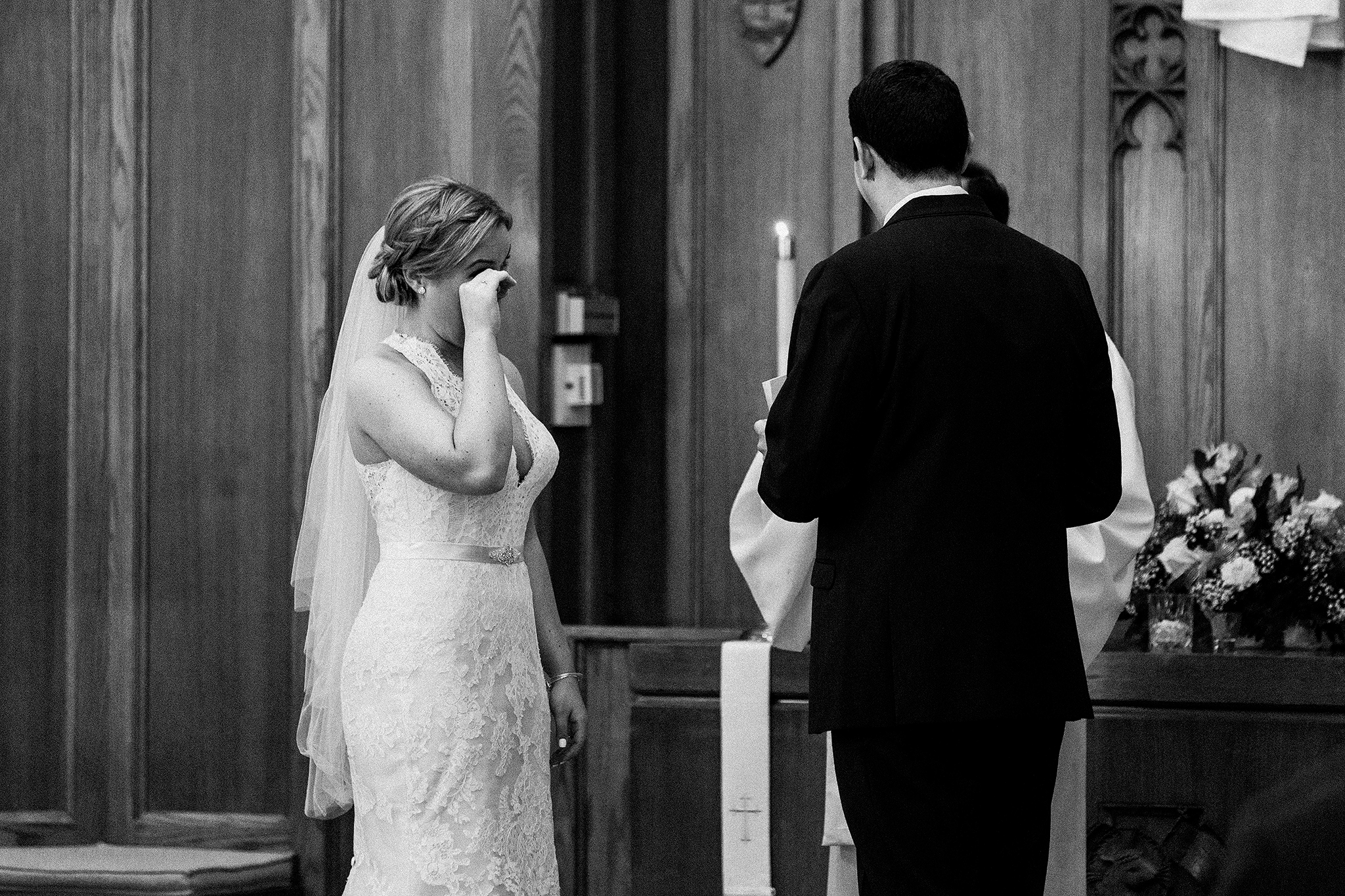 bride wiping away tears during wedding ceremony | dekalb, il wedding photographer