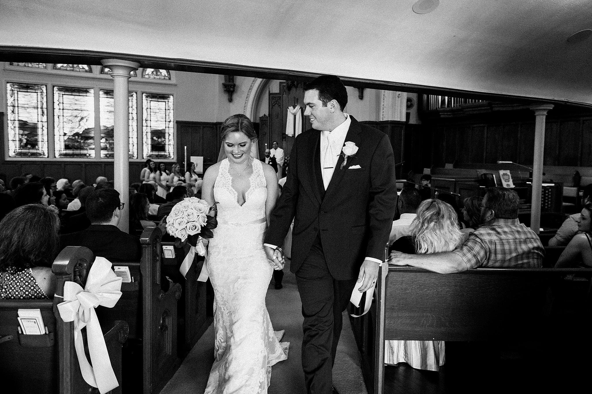 bride and groom exiting down the aisle | dekalb, il wedding photographer