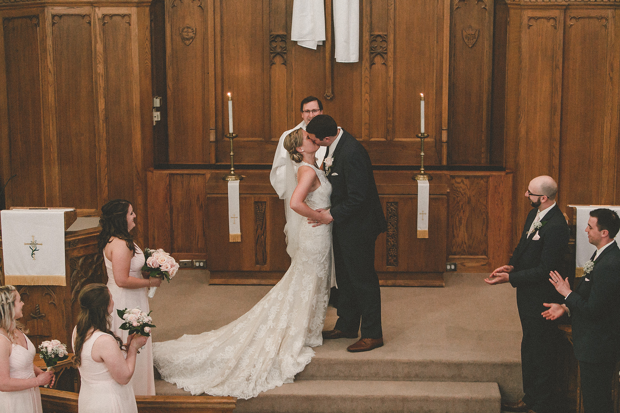bride and groom kissing at the altar | dekalb il wedding photographer