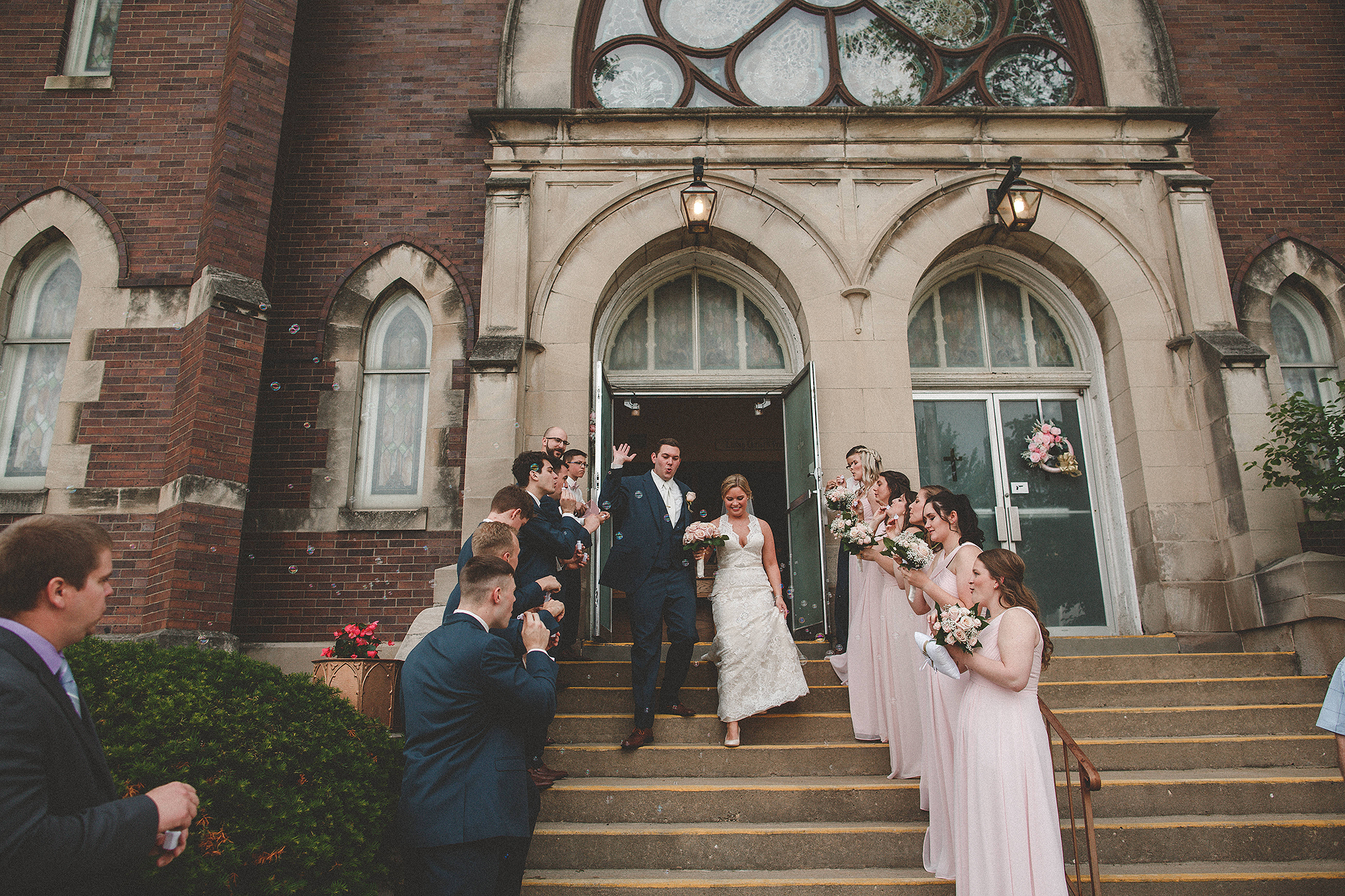 bride and groom bubble exit | dekalb, il wedding photographer