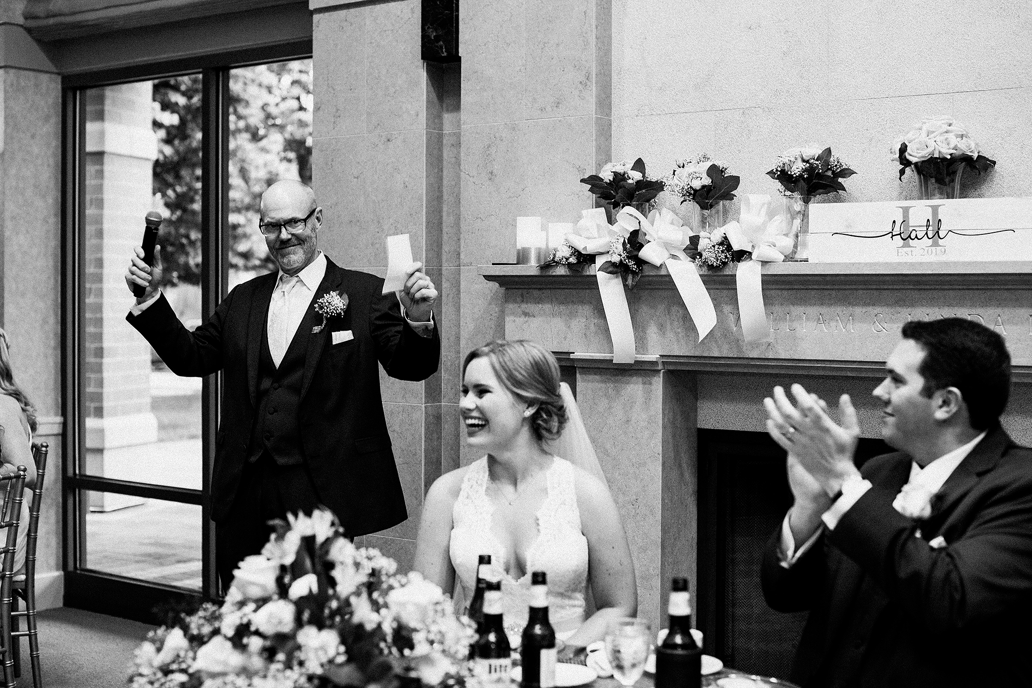 father of the bride speech with laughing bride and groom | dekalb, il wedding photographer