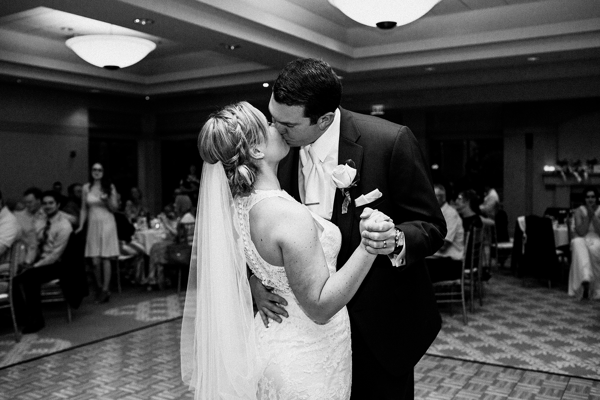 bride and groom first dance, kissing | barsema alumni center dekalb Il wedding photographer