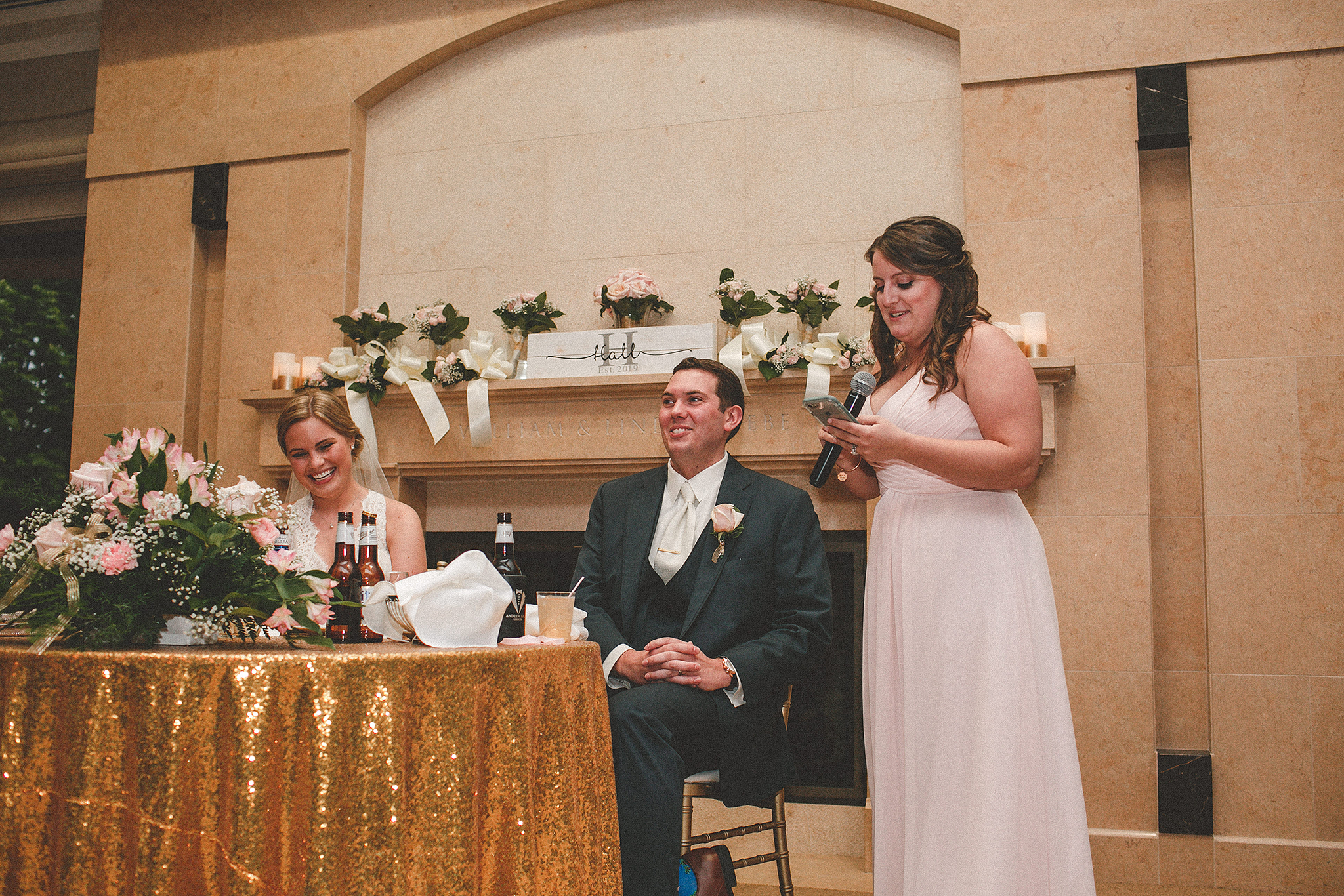 maid of honor toast, bride and groom laughing | dekalb, il wedding photographer