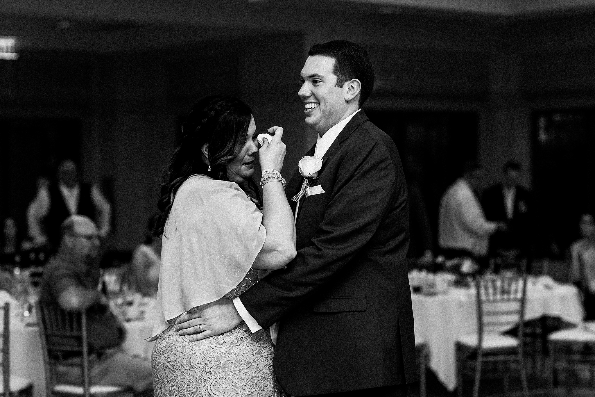 groom and mother dancing, mother wiping tears | barsema alumni center dekalb IL wedding photographer