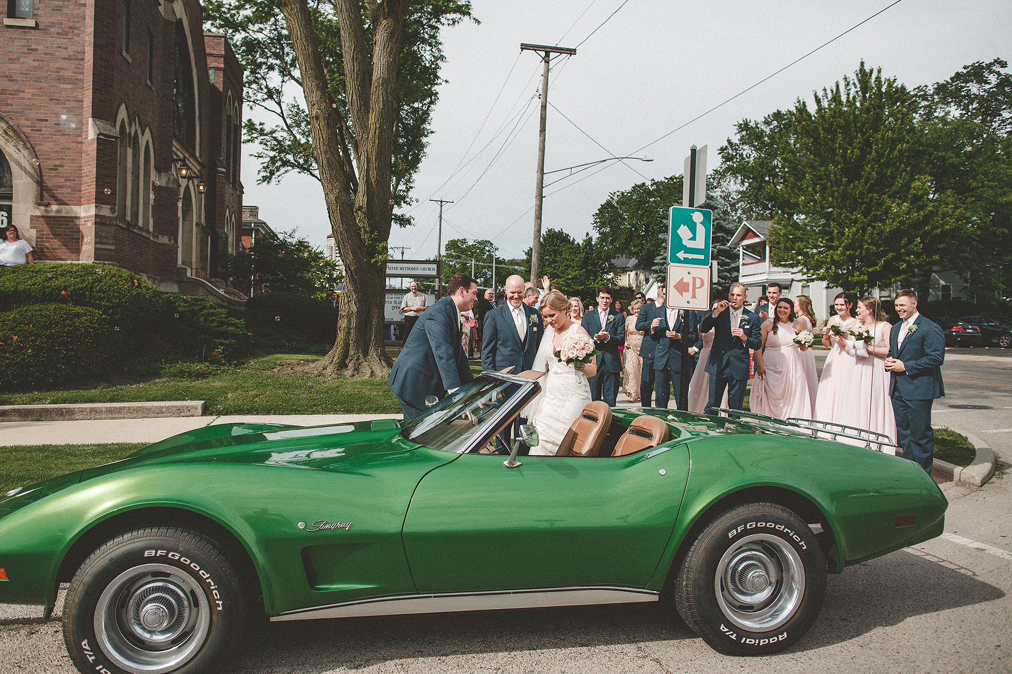 bride and groom bubble exit to a green classic 75 corvette stingray | dekalb, il wedding photographer