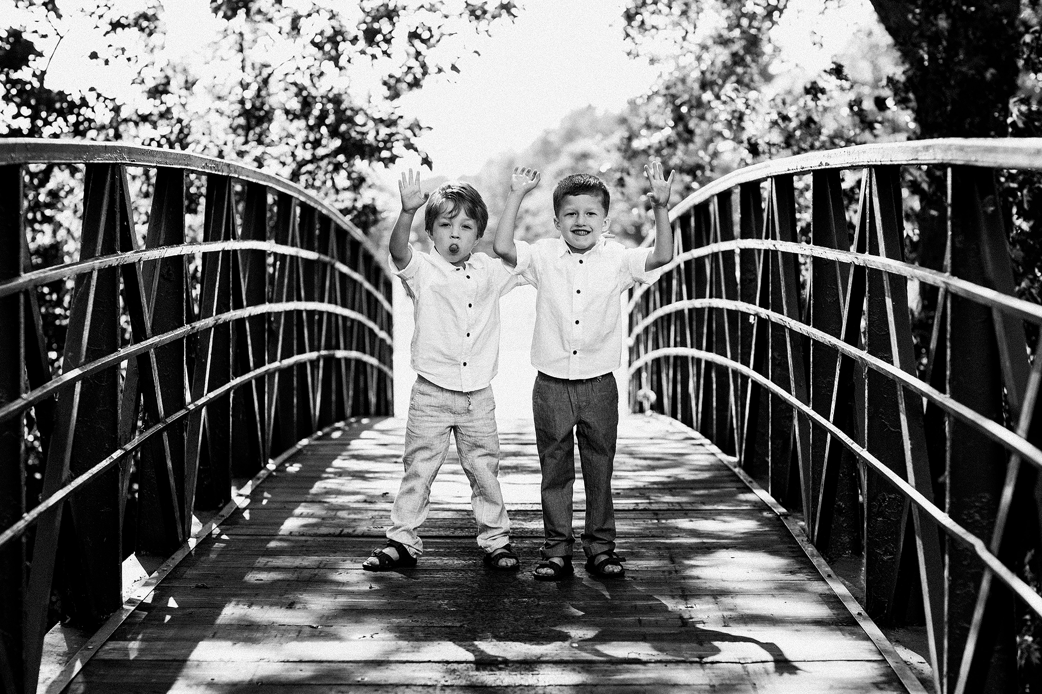 photo of two young brothers on a bridge | family photos outside | sycamore il family photographer