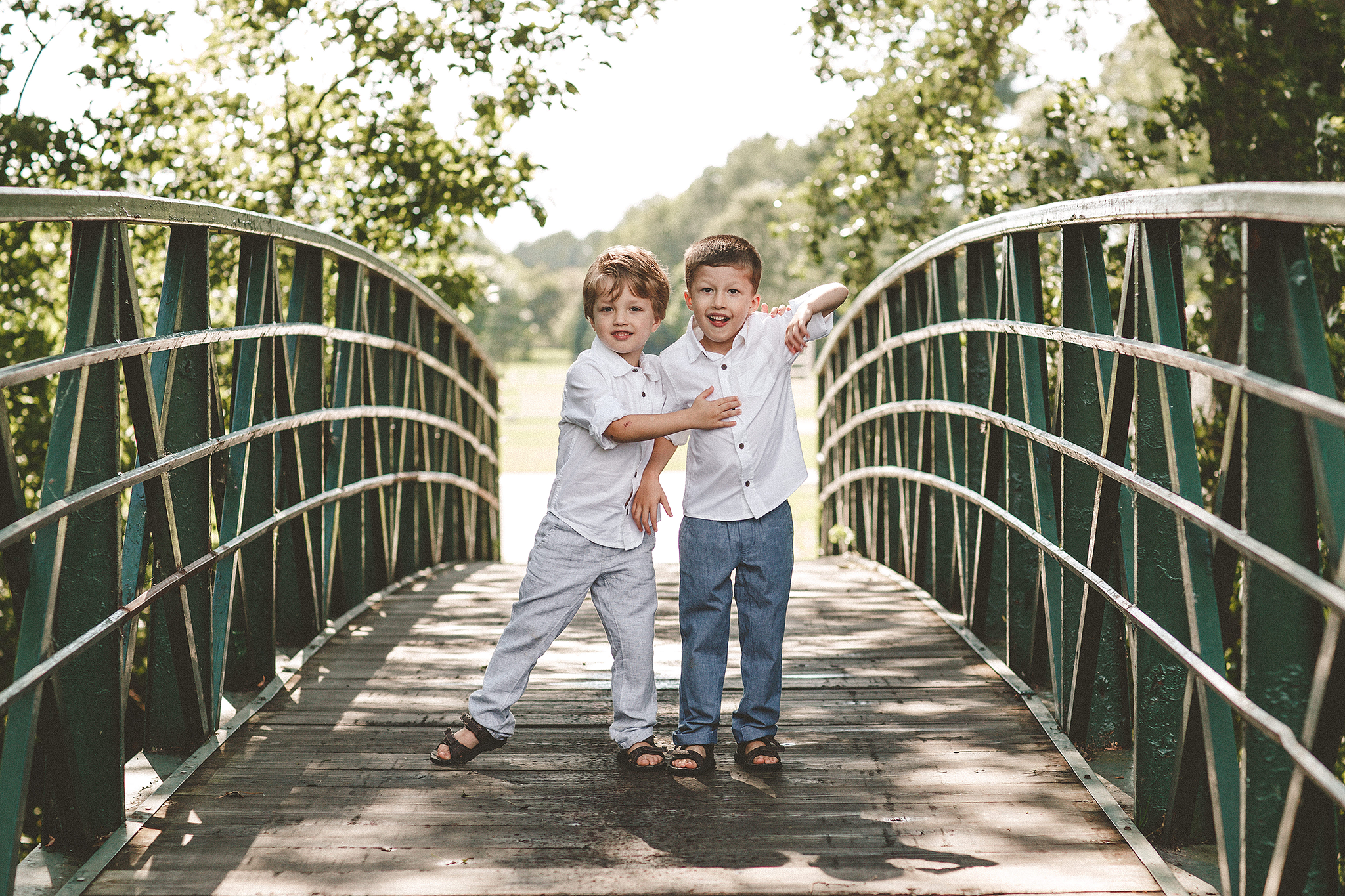picture of two brothers on a bridge | family photos outside | sycamore il family photographer