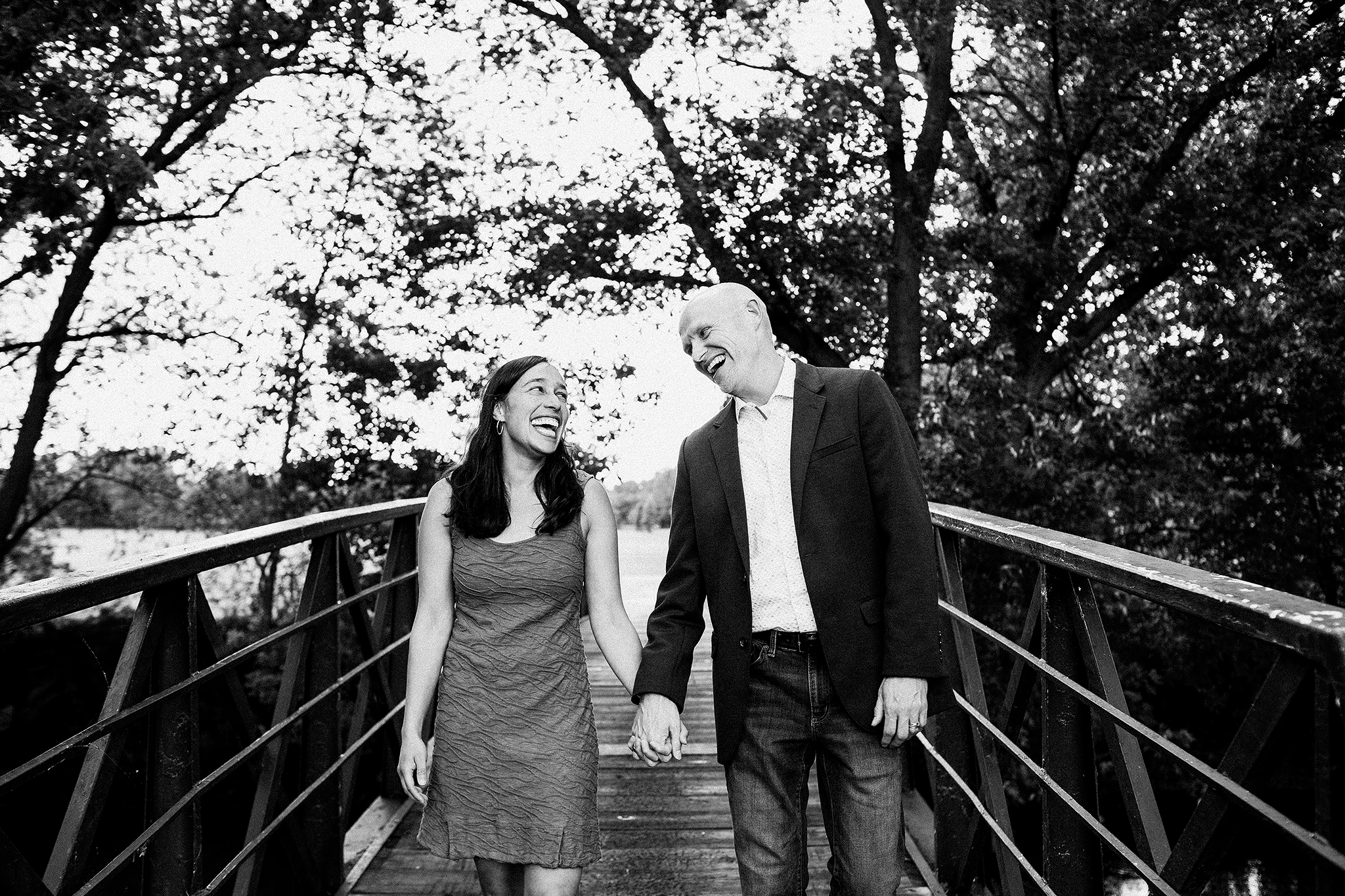 portrait of husband, wife walking on a bridge, laughing | sycamore il family photographer