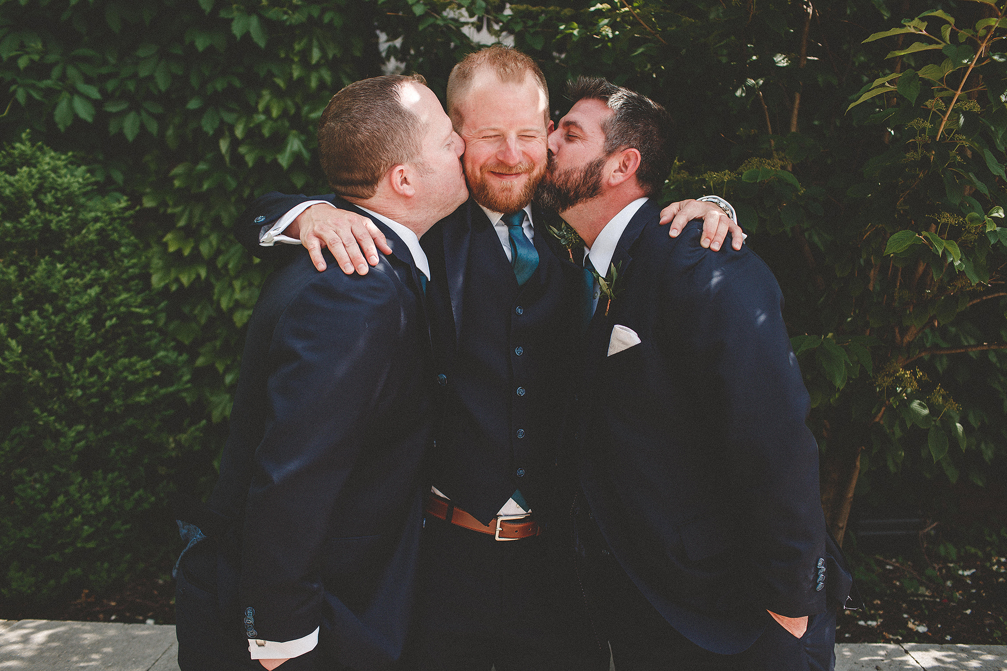 groomsmen kissing groom's cheeks | the ivy house milwaukee wedding photographer | chrissy deming